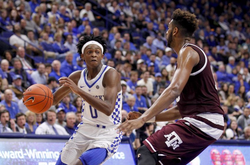 Jan 3, 2017; Lexington, KY, USA; Kentucky Wildcats guard De'Aaron Fox (0) dribbles the ball against Texas A&M Aggies forward Tonny Trocha-Morelos (10) in the second half at Rupp Arena. Kentucky defeated Texas A&M 100-58. Mandatory Credit: Mark Zerof-USA TODAY Sports