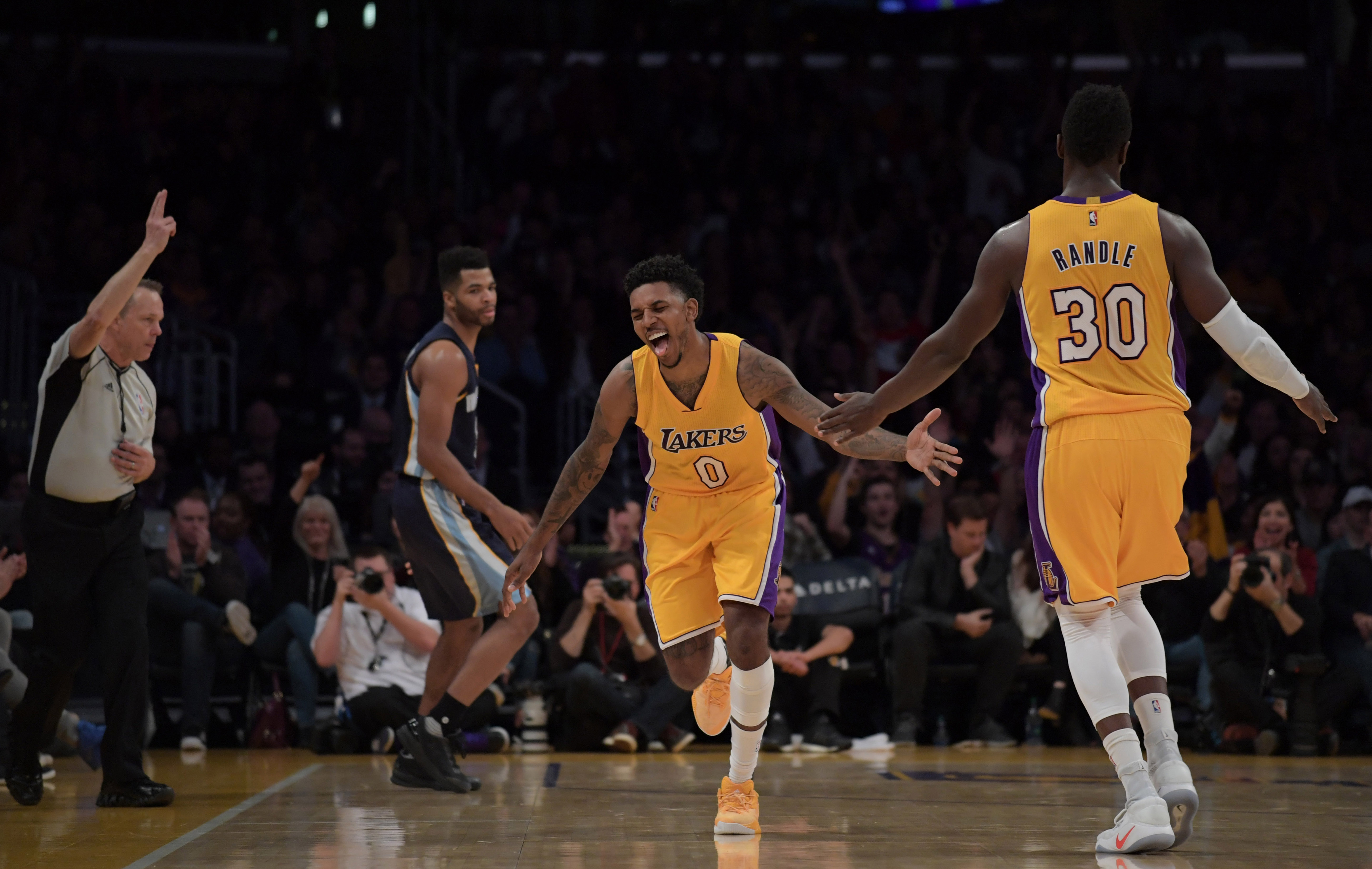 Jan 3, 2017; Los Angeles, CA, USA; Los Angeles Lakers guard Nick Young (0) is congratulated by Los Angeles Lakers forward Julius Randle (30) after a 3-point basket in the first half against the Memphis Grizzlies during a NBA game at Staples Center. Mandatory Credit: Kirby Lee-USA TODAY Sports