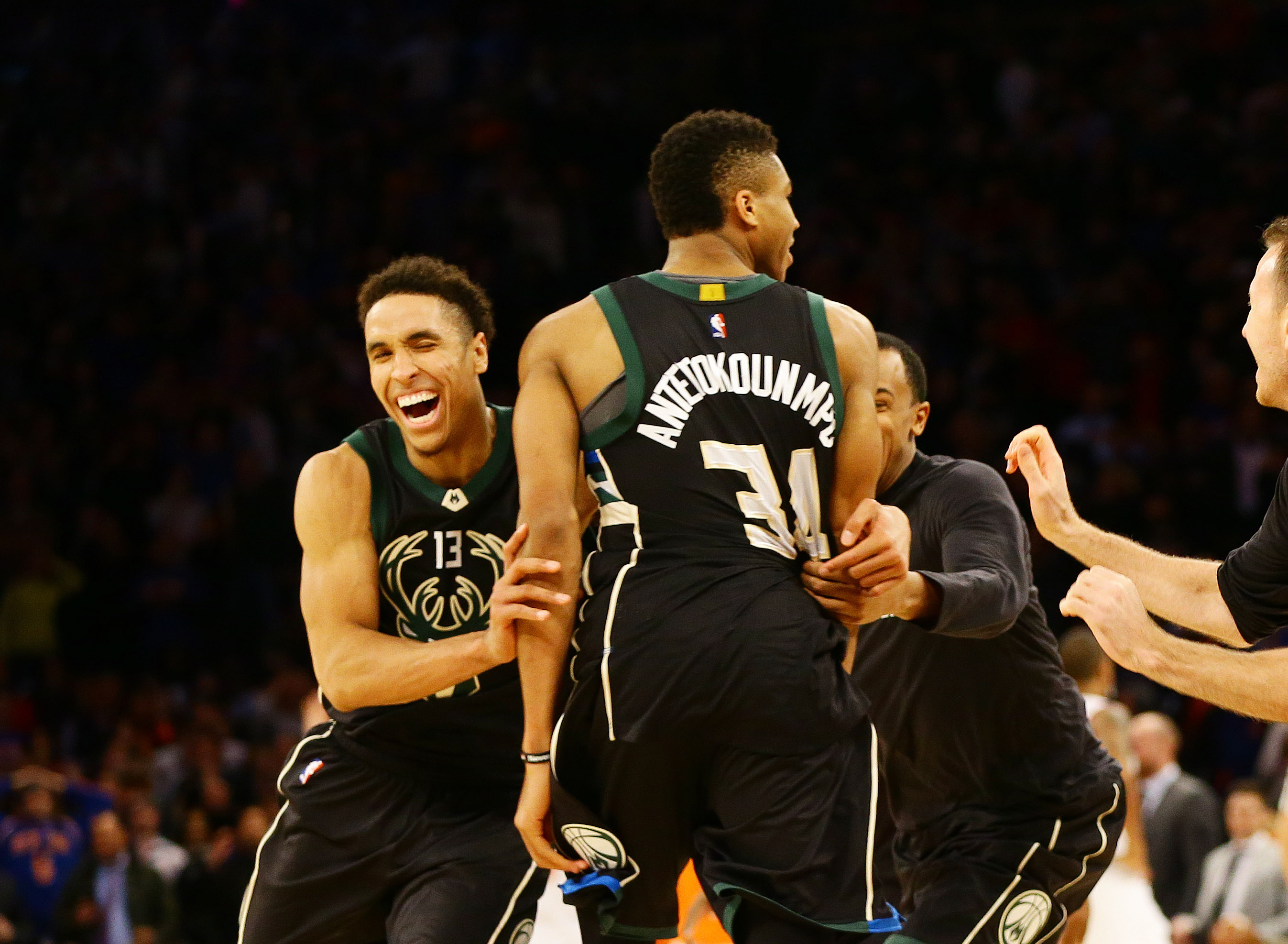 Jan 4, 2017; New York, NY, USA; Milwaukee Bucks forward Giannis Antetokounmpo (34) is congratulated by guard Malcolm Brogdon (13) after scoring the game winning basket at the buzzer against New York Knicks during the second half at Madison Square Garden. The Bucks won 105-104. Mandatory Credit: Andy Marlin-USA TODAY Sports