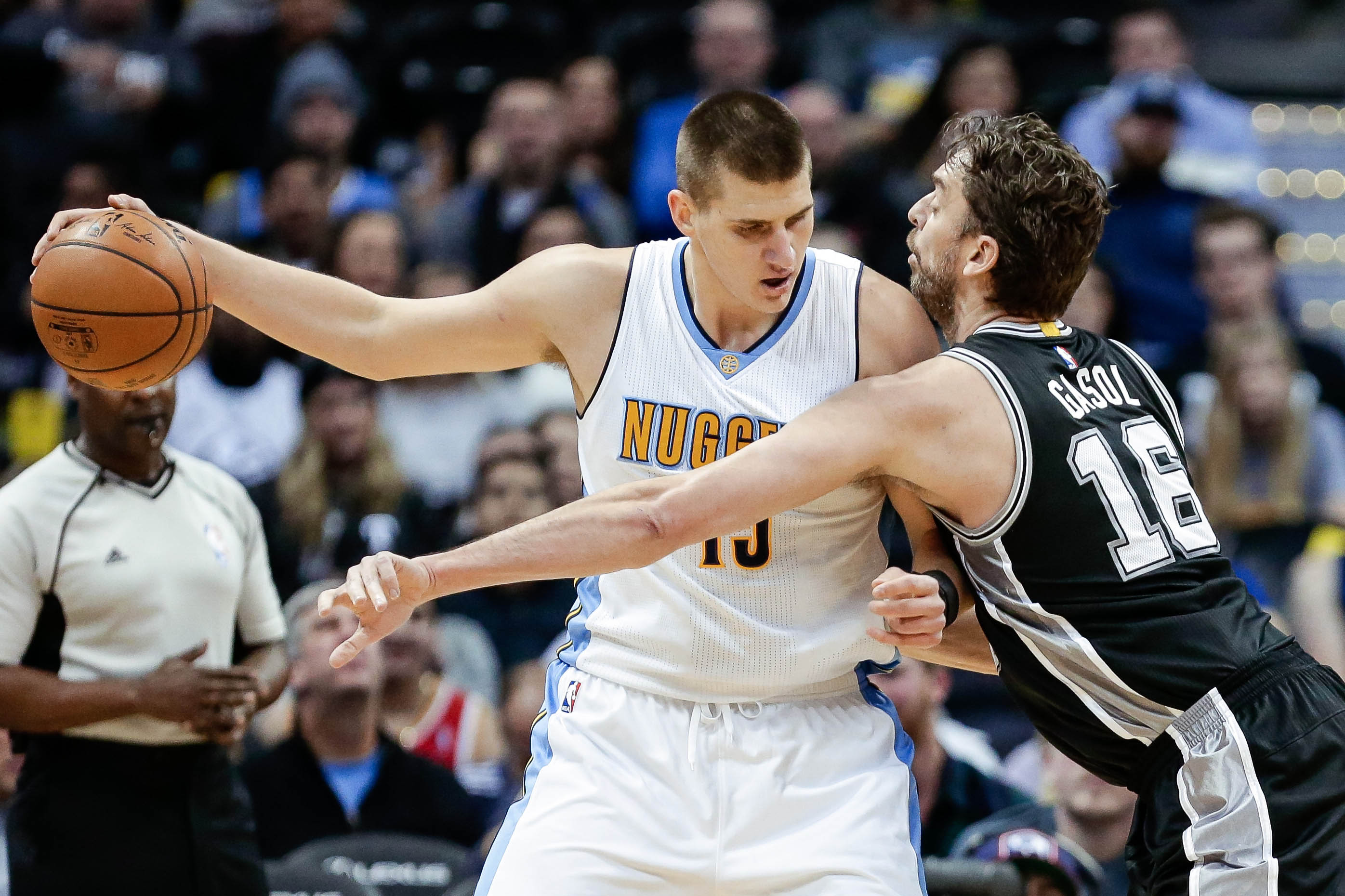 Jan 5, 2017; Denver, CO, USA; San Antonio Spurs center Pau Gasol (16) guards Denver Nuggets forward Nikola Jokic (15) in the first quarter at the Pepsi Center. Mandatory Credit: Isaiah J. Downing-USA TODAY Sports