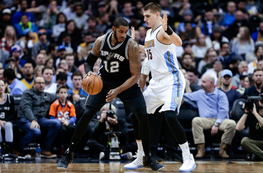 Jan 5, 2017; Denver, CO, USA; Denver Nuggets forward Nikola Jokic (15) guards San Antonio Spurs forward LaMarcus Aldridge (12) in the third quarter at the Pepsi Center. The Spurs won 127-99. Mandatory Credit: Isaiah J. Downing-USA TODAY Sports