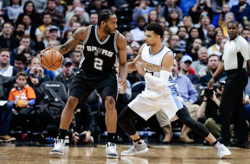 Jan 5, 2017; Denver, CO, USA; Denver Nuggets guard Jamal Murray (27) guards San Antonio Spurs forward Kawhi Leonard (2) in the fourth quarter at the Pepsi Center. The Spurs won 127-99. Mandatory Credit: Isaiah J. Downing-USA TODAY Sports
