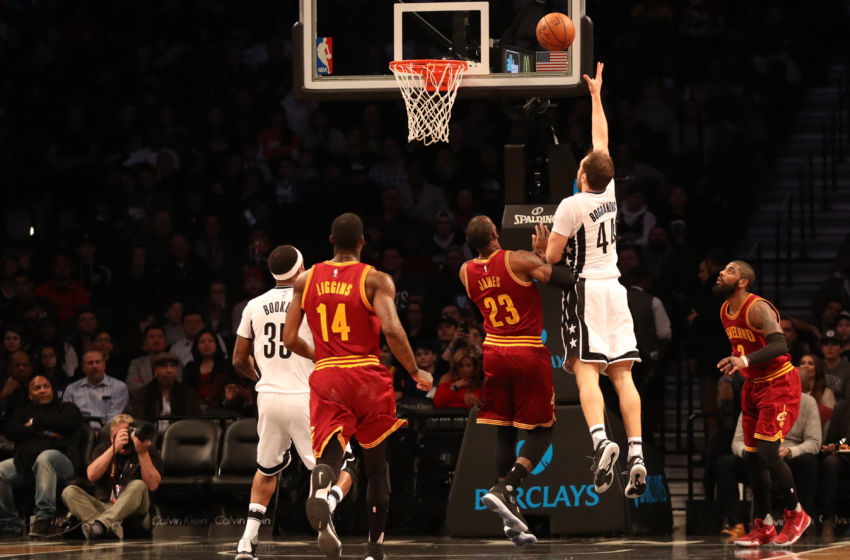 Jan 6, 2017; Brooklyn, NY, USA; Brooklyn Nets guard Bojan Bogdanovic (44) shoots the ball over Cleveland Cavaliers forward LeBron James (23) during the first quarter at Barclays Center. Mandatory Credit: Anthony Gruppuso-USA TODAY Sports