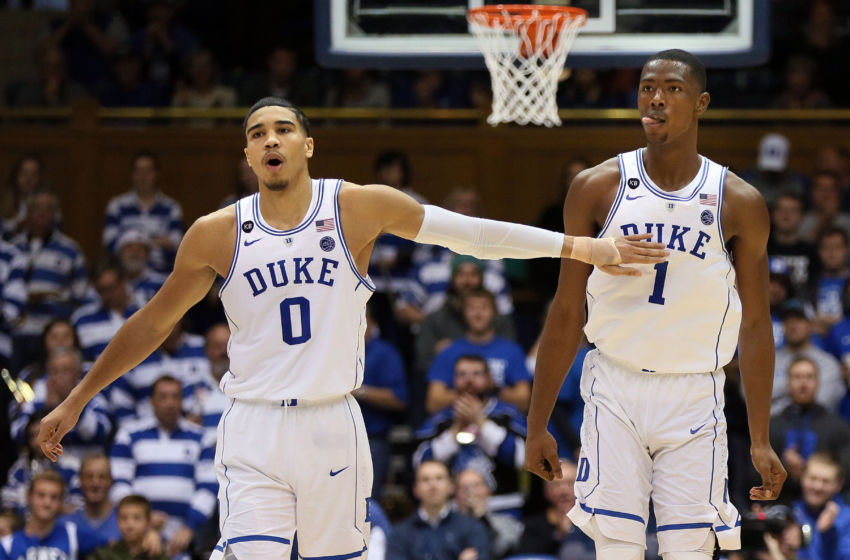 Jan 7, 2017; Durham, NC, USA; Duke Blue Devils forward Jayson Tatum (0) and forward Harry Giles (1) react after a Duke score during the second half of their game against the Boston College Eagles at Cameron Indoor Stadium. Mandatory Credit: Mark Dolejs-USA TODAY Sports