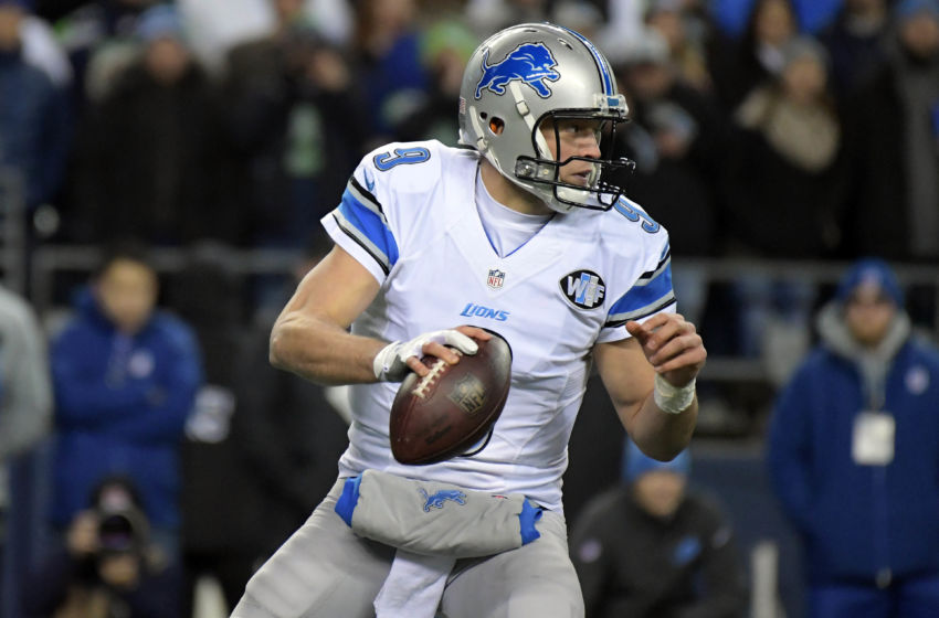 January 7, 2017; Seattle, WA, USA; Detroit Lions quarterback Matthew Stafford (9) rolls out to pass against the Seattle Seahawks during the first half in the NFC Wild Card playoff football game at CenturyLink Field. Mandatory Credit: Kirby Lee-USA TODAY Sports
