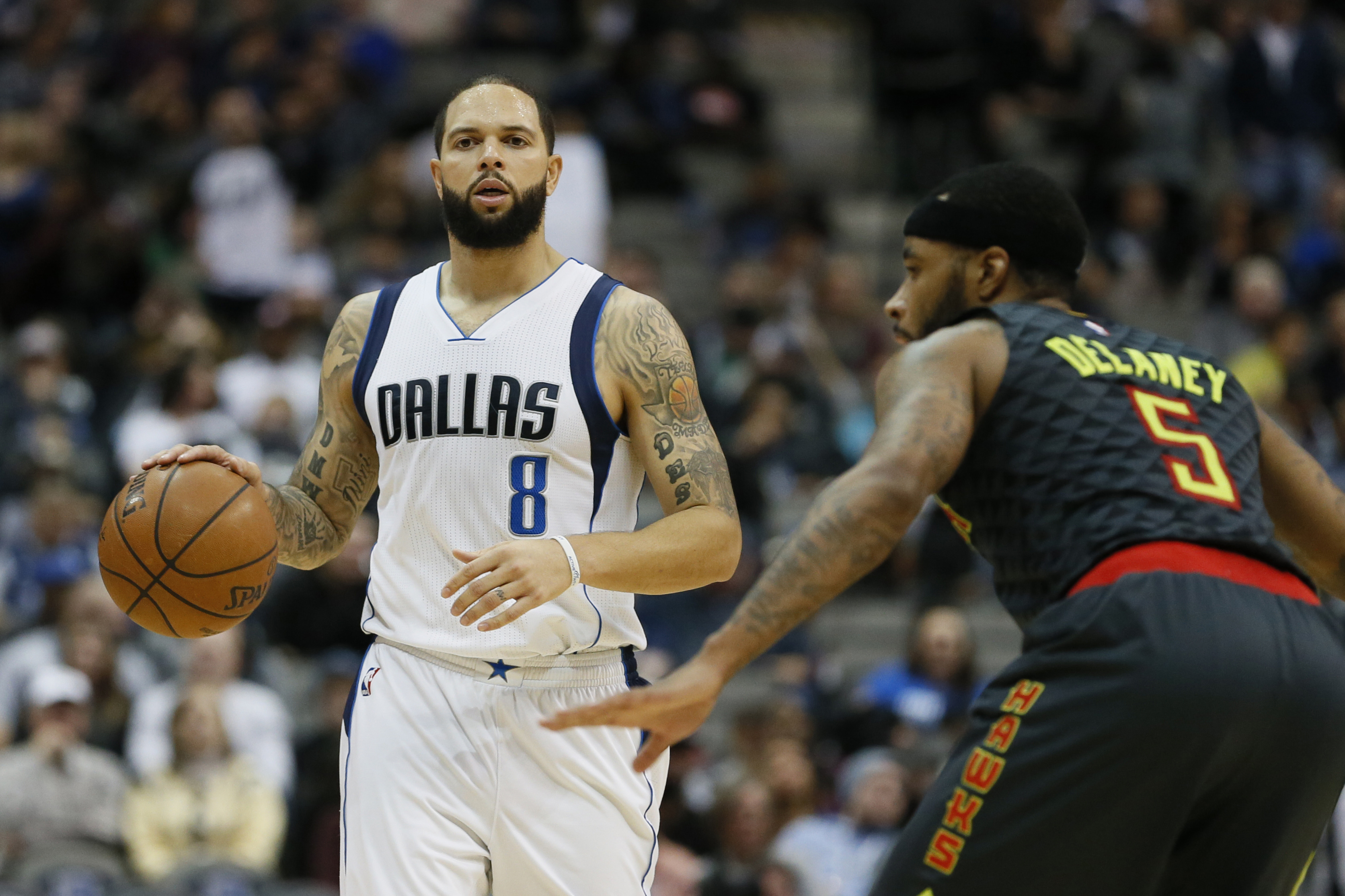 Jan 7, 2017; Dallas, TX, USA; Dallas Mavericks guard Deron Williams (8) is guarded by Atlanta Hawks guard Malcolm Delaney (5) in the fourth quarter at American Airlines Center. Mandatory Credit: Tim Heitman-USA TODAY Sports