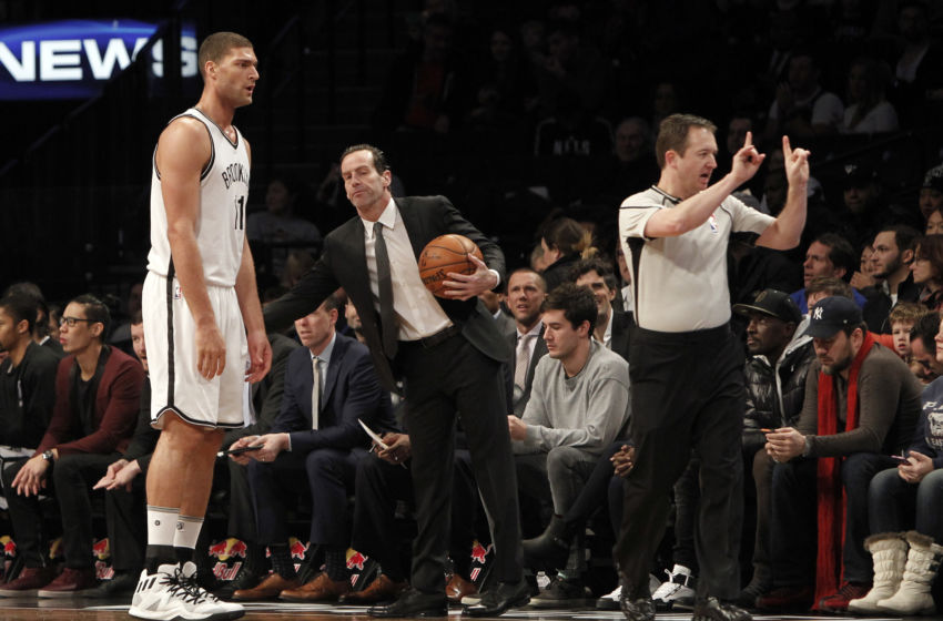 Jan 8, 2017; Brooklyn, NY, USA; Brooklyn Nets head coach Kenny Atkinson reacts with center Brook Lopez (11) during the second quarter against Philadelphia 76ers at Barclays Center. Mandatory Credit: Nicole Sweet-USA TODAY Sports