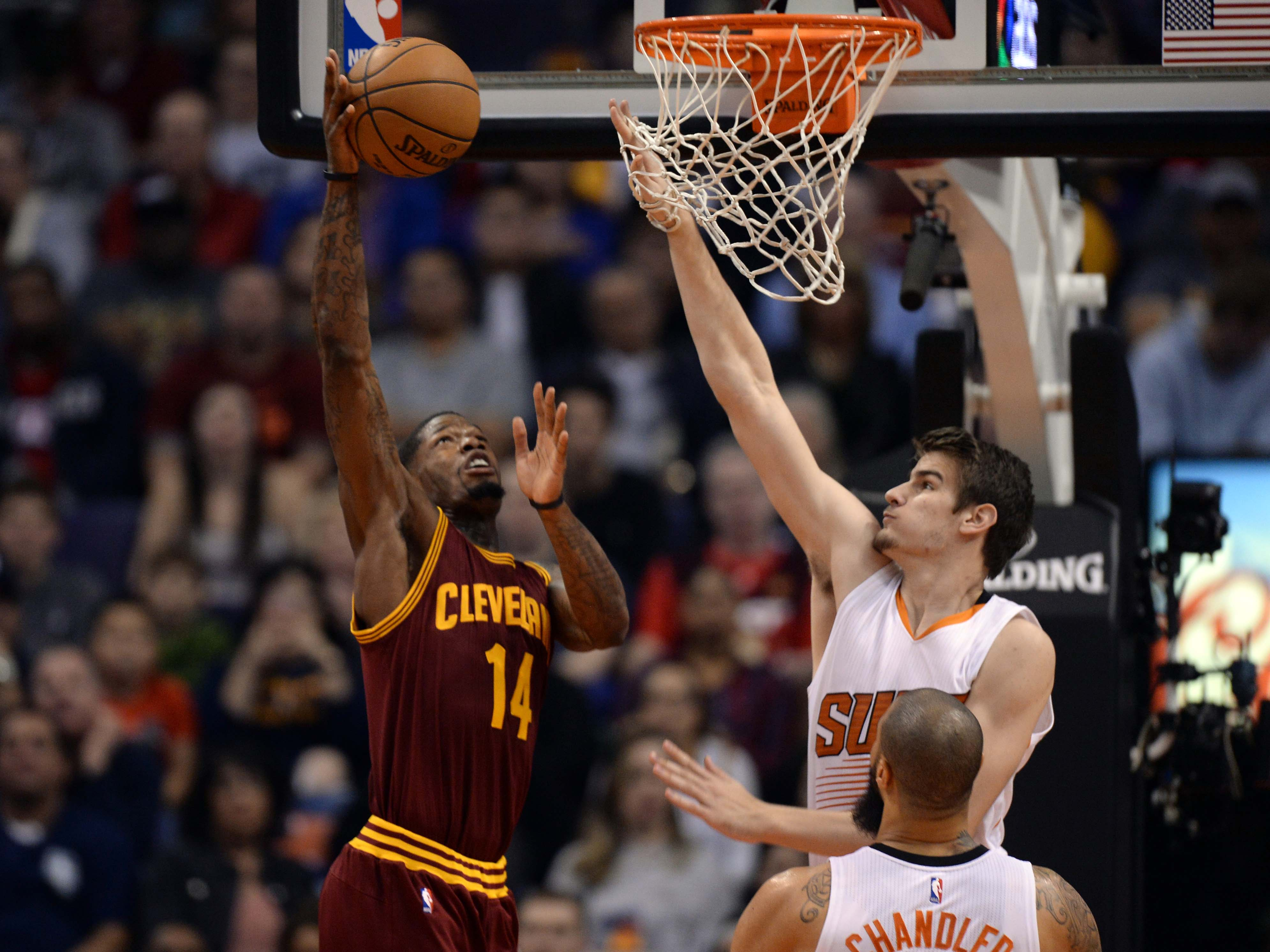 Jan 8, 2017; Phoenix, AZ, USA; Cleveland Cavaliers guard DeAndre Liggins (14) attempts a shot over Phoenix Suns forward Dragan Bender (35) during the first half at Talking Stick Resort Arena. Mandatory Credit: Joe Camporeale-USA TODAY Sports