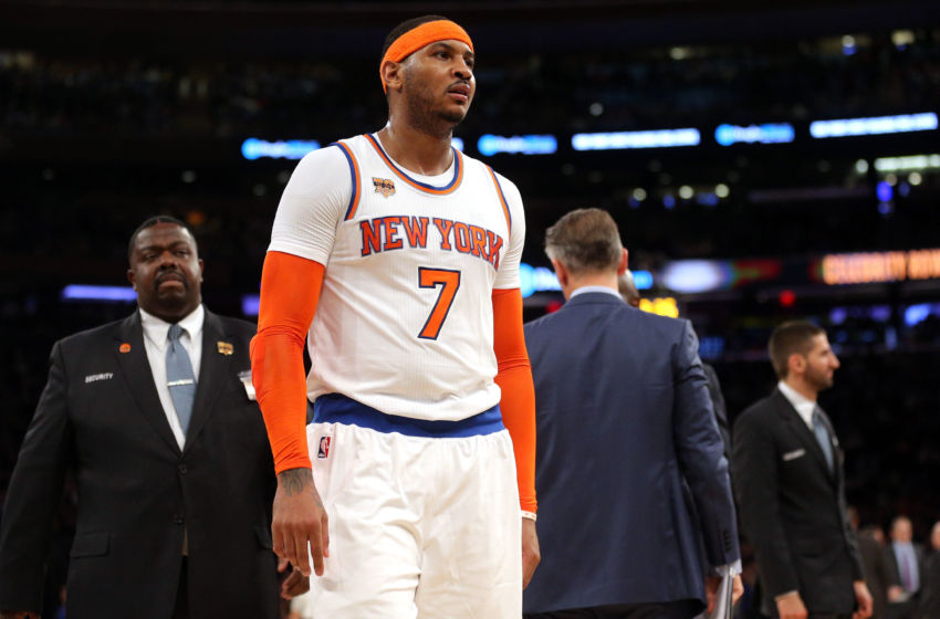 Jan 9, 2017; New York, NY, USA; New York Knicks small forward Carmelo Anthony (7) is escorted off the court after being ejected during the third quarter against the New Orleans Pelicans at Madison Square Garden. Mandatory Credit: Brad Penner-USA TODAY Sports