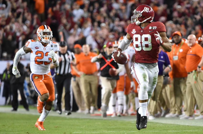 Jan 9, 2017; Tampa, FL, USA; Alabama Crimson Tide tight end O.J. Howard (88) runs a touchdown ahead of Clemson Tigers safety Van Smith (23) during the third quarter in the 2017 College Football Playoff National Championship Game at Raymond James Stadium. Mandatory Credit: Steve Mitchell-USA TODAY Sports