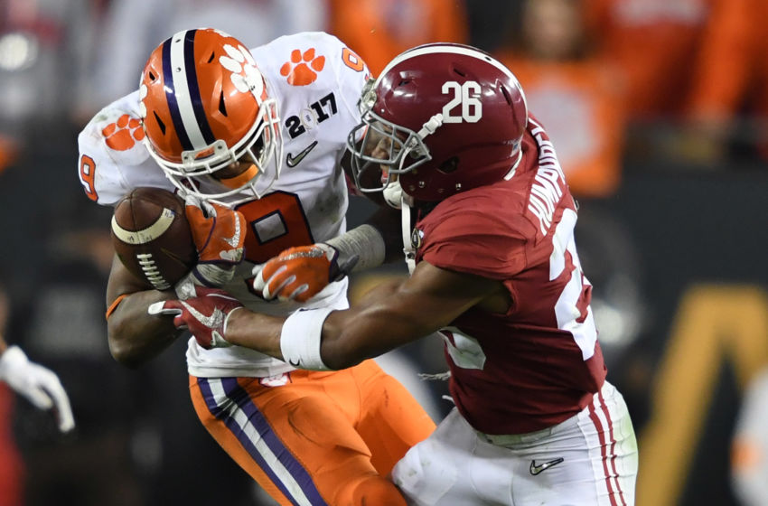 Jan 9, 2017; Tampa, FL, USA; Clemson Tigers running back Wayne Gallman (9) works to control the ball while defended by Alabama Crimson Tide defensive back Marlon Humphrey (26) during the fourth quarter in the 2017 College Football Playoff National Championship Game at Raymond James Stadium. Mandatory Credit: John David Mercer-USA TODAY Sports