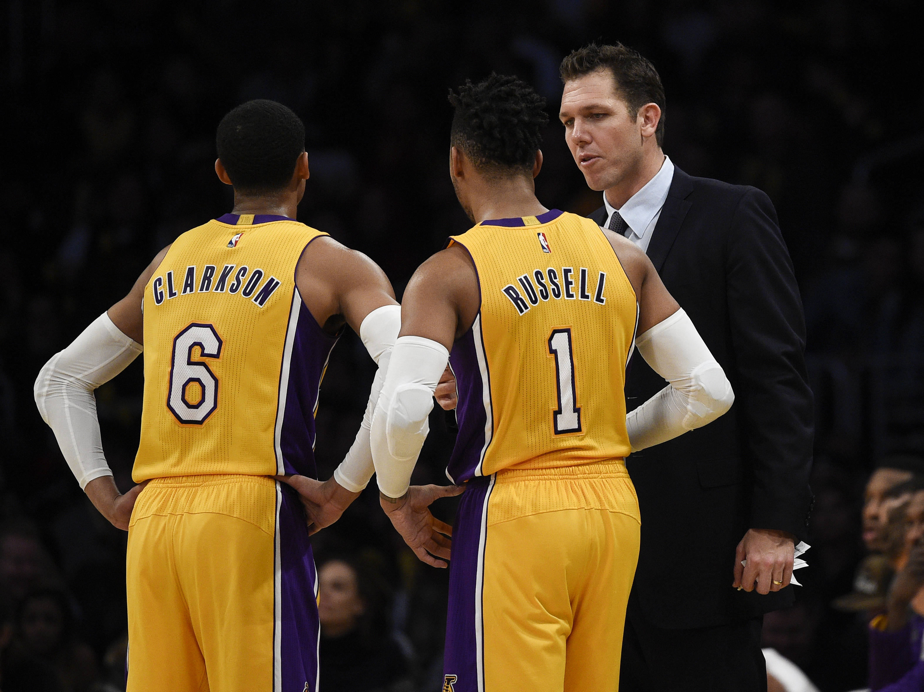 Jan 10, 2017; Los Angeles, CA, USA; Los Angeles Lakers head coach Luke Walton (right) talks with guard D'Angelo Russell (1) and guard Jordan Clarkson (6) during the fourth quarter against the Portland Trail Blazers at Staples Center. The Portland Trail Blazers won 108-87. Mandatory Credit: Kelvin Kuo-USA TODAY Sports