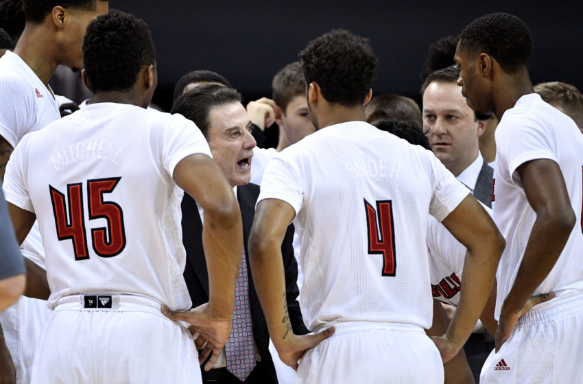 Jan 11, 2017; Louisville, KY, USA; Louisville Cardinals head coach Rick Pitino talks with his players in a time out during the first half against the Pittsburgh Panthers at KFC Yum! Center. Mandatory Credit: Jamie Rhodes-USA TODAY Sports