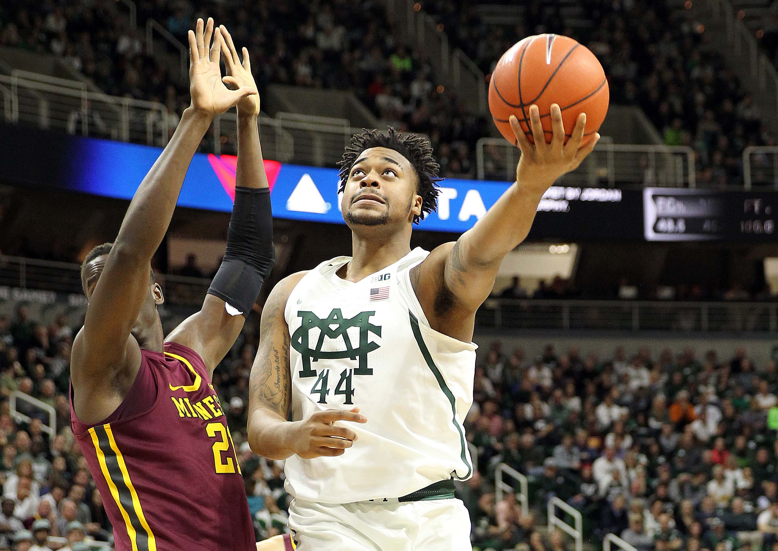 9803901-ncaa-basketball-minnesota-at-michigan-state