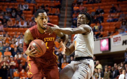 Jan 11, 2017; Stillwater, OK, USA; Iowa State Cyclones guard Monte Morris (11) drives to the basket defended by Oklahoma State Cowboys guard Brandon Averette (0) during the first half at Gallagher-Iba Arena. Mandatory Credit: Rob Ferguson-USA TODAY Sports