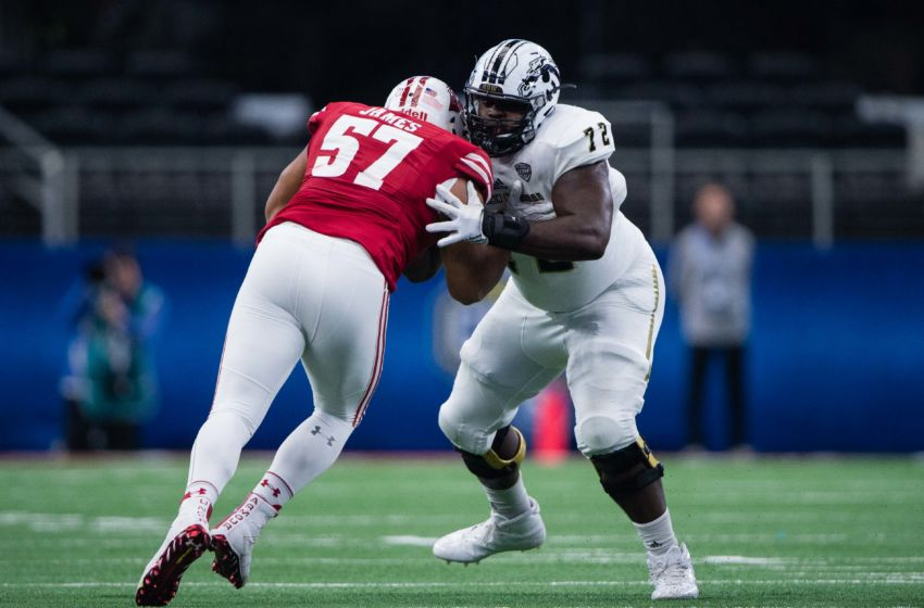 Jan 2, 2017; Arlington, TX, USA; Wisconsin Badgers defensive end Alec James (57) and Western Michigan Broncos offensive lineman Taylor Moton (72) in action in the 2017 Cotton Bowl game at AT&T Stadium. The Badgers defeat the Broncos 24-16. Mandatory Credit: Jerome Miron-USA TODAY Sports