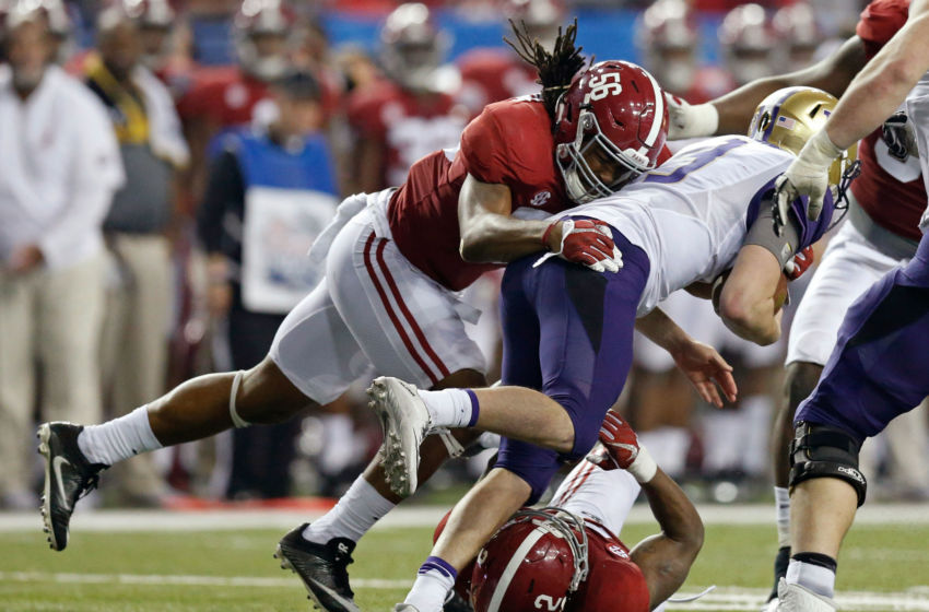 Dec 31, 2016; Atlanta, GA, USA; Washington Huskies quarterback Jake Browning (3) is tackled by Alabama Crimson Tide linebacker Tim Williams (56) and defensive back Tony Brown (2, bottom) during the third quarter in the 2016 CFP Semifinal at the Georgia Dome. Alabama defeated Washington 24-7. Mandatory Credit: Jason Getz-USA TODAY Sports