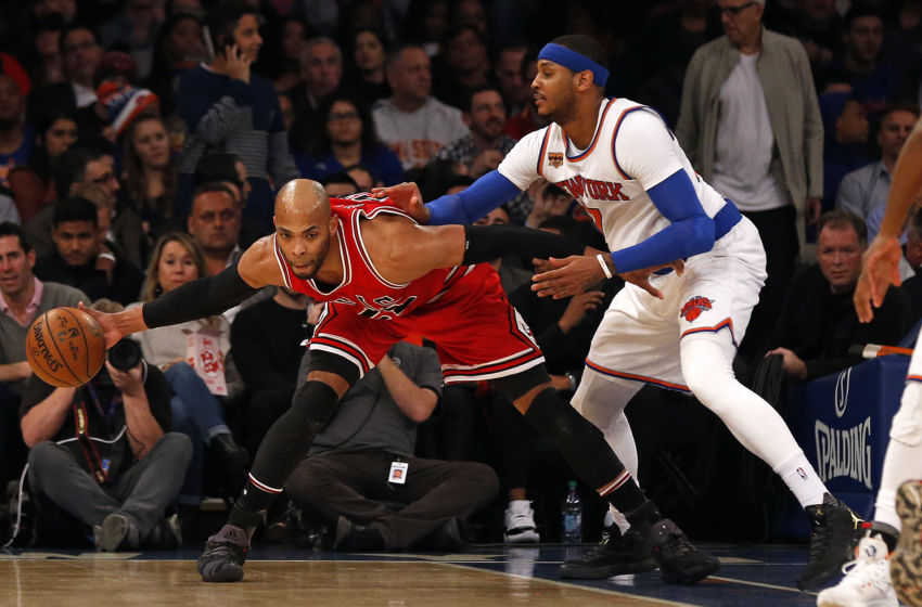 Jan 12, 2017; New York, NY, USA; Chicago Bulls forward Taj Gibson (22) controls the ball while being defended by New York Knicks forward Carmelo Anthony (7) during the first quarter at Madison Square Garden. Mandatory Credit: Adam Hunger-USA TODAY Sports