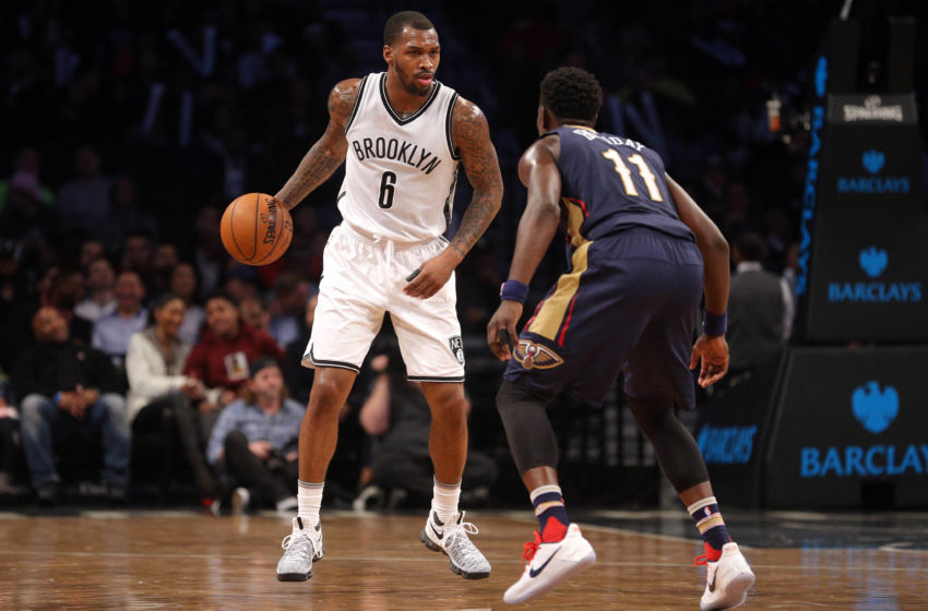 Jan 12, 2017; Brooklyn, NY, USA; Brooklyn Nets shooting guard Sean Kilpatrick (6) controls the ball against New Orleans Pelicans point guard Jrue Holiday (11) during the fourth quarter at Barclays Center. Mandatory Credit: Brad Penner-USA TODAY Sports