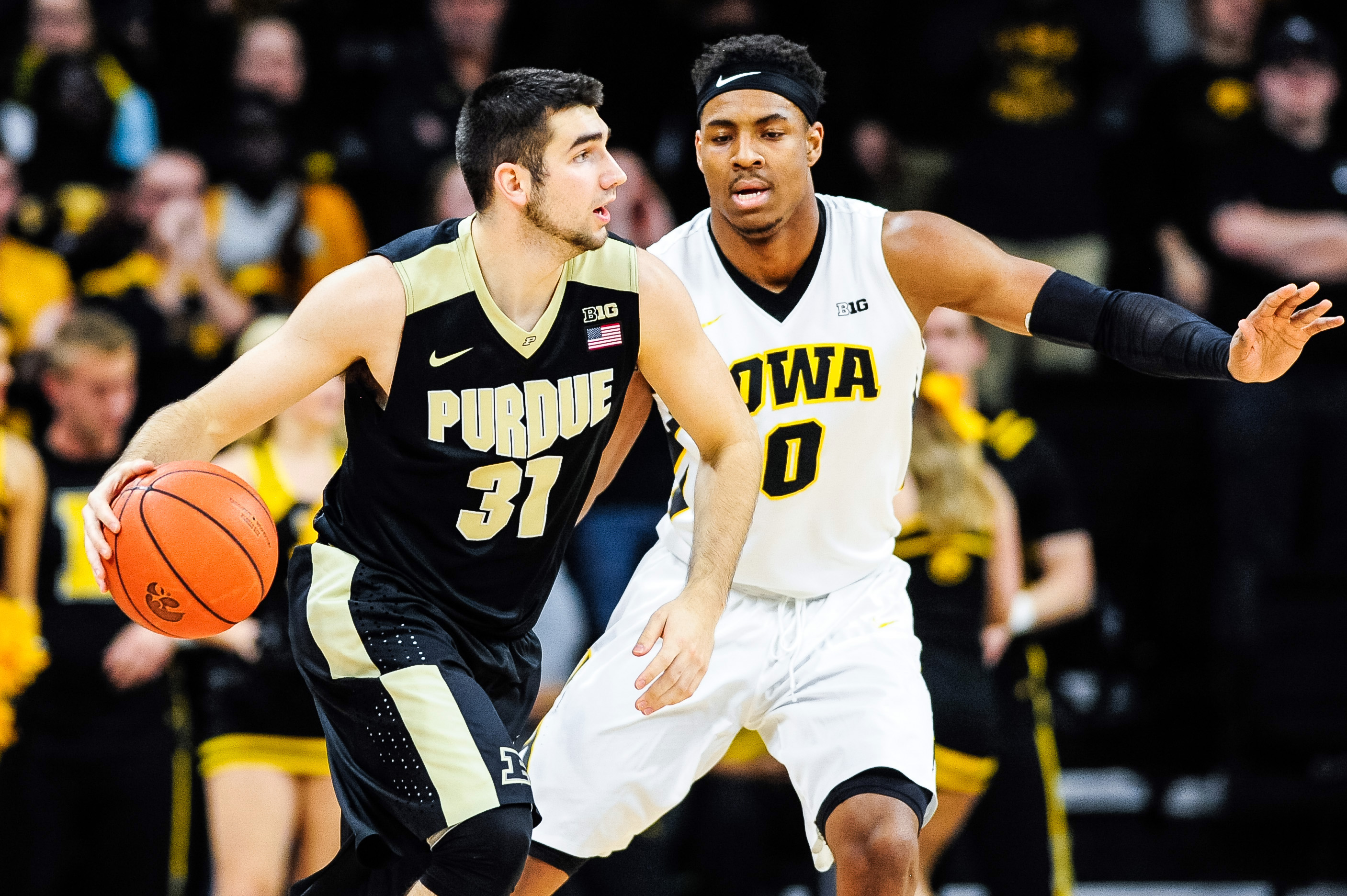 Jan 12, 2017; Iowa City, IA, USA; Purdue Boilermakers guard Dakota Mathias (31) is defended by Iowa Hawkeyes forward Ahmad Wagner (0) during the second half at Carver-Hawkeye Arena. Iowa won 83-78. Mandatory Credit: Jeffrey Becker-USA TODAY Sports