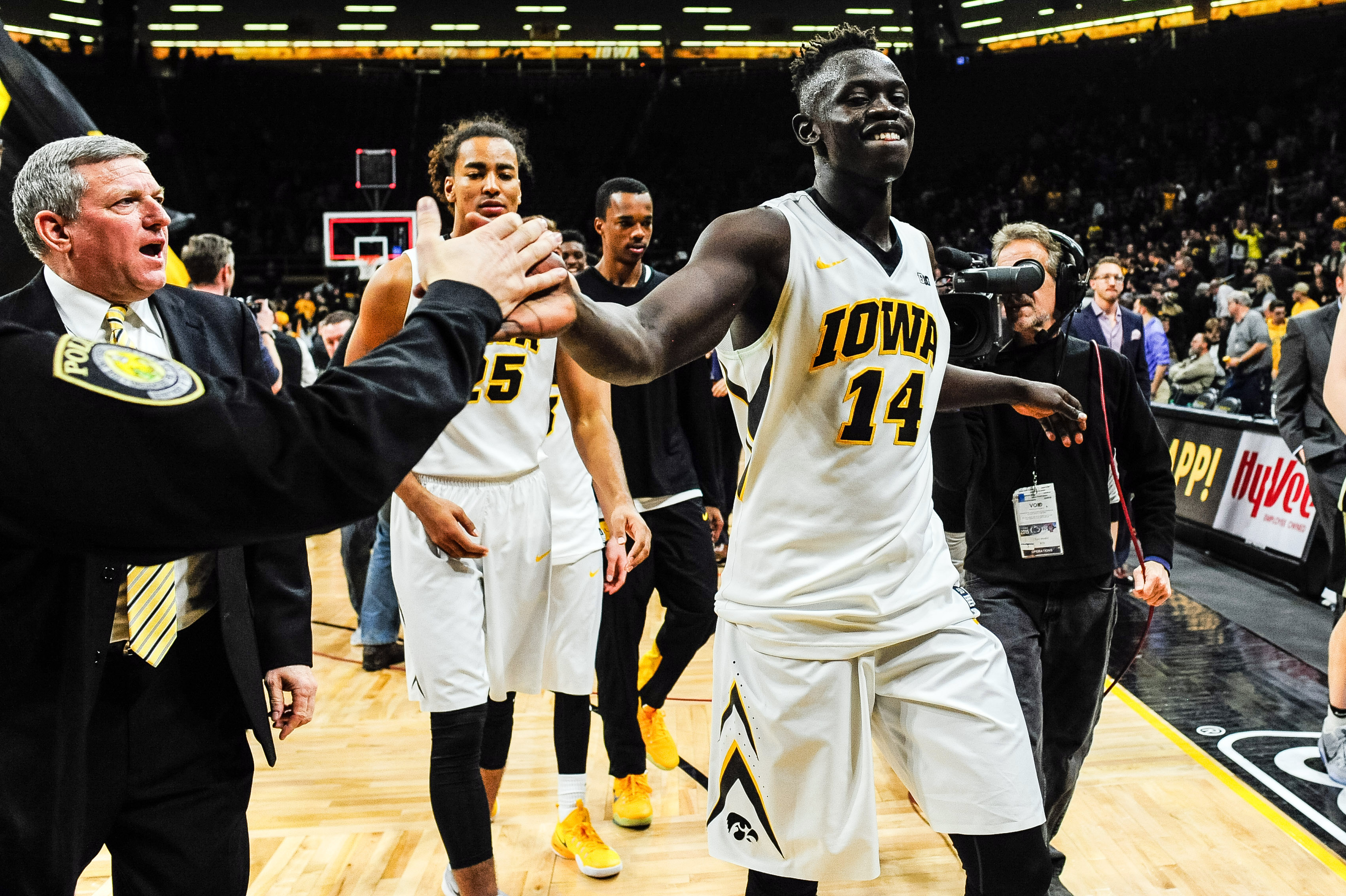 Jan 12, 2017; Iowa City, IA, USA; Iowa Hawkeyes guard Peter Jok (14) is congratulated coming off the court as assistant coach Kirk Speraw looks on after the game at Carver-Hawkeye Arena. Iowa won 83-78. Mandatory Credit: Jeffrey Becker-USA TODAY Sports
