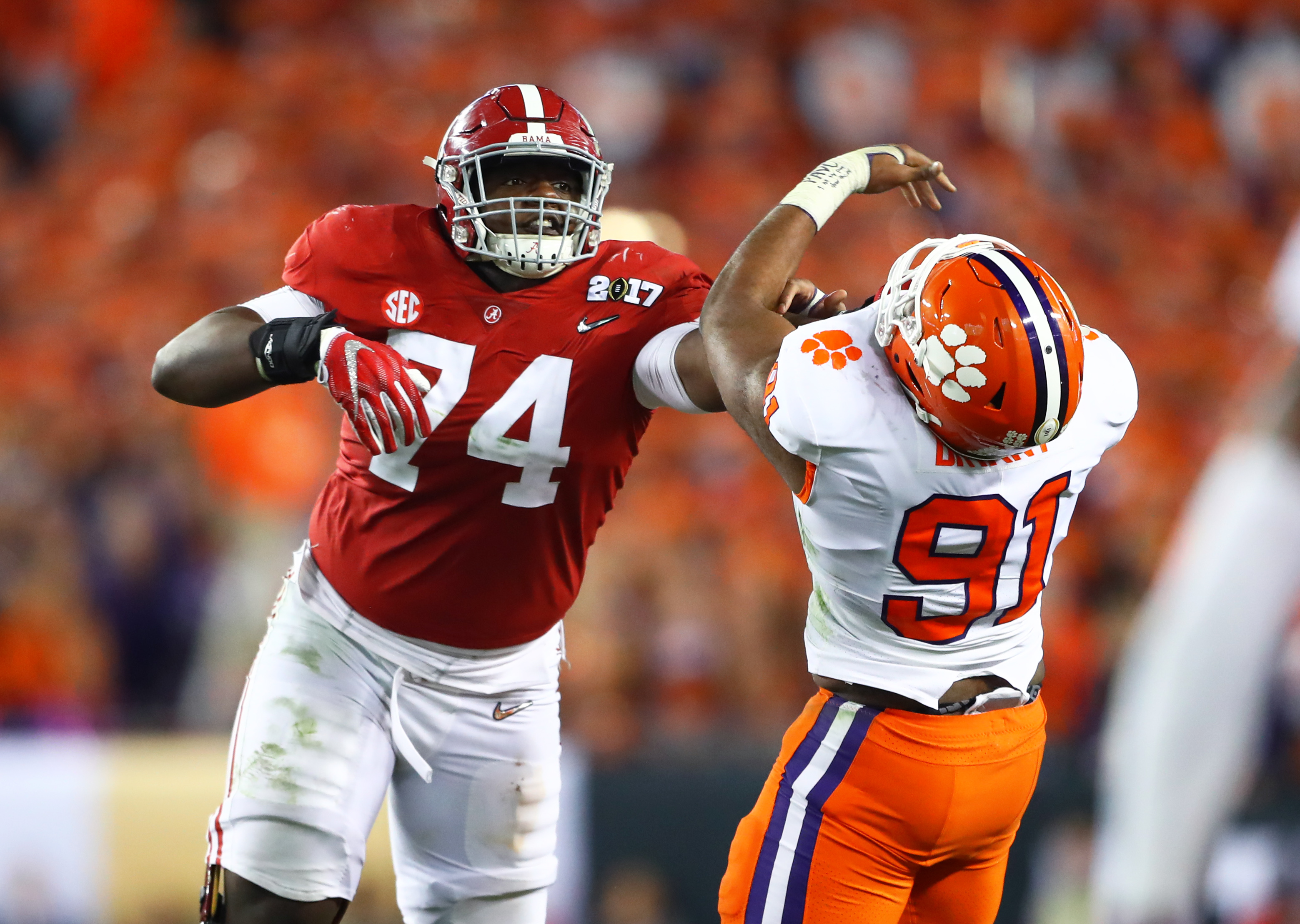 Jan 9, 2017; Tampa, FL, USA; Alabama Crimson Tide offensive lineman Cam Robinson (74) against Clemson Tigers defensive end Austin Bryant (91) in the 2017 College Football Playoff National Championship Game at Raymond James Stadium. Mandatory Credit: Mark J. Rebilas-USA TODAY Sports