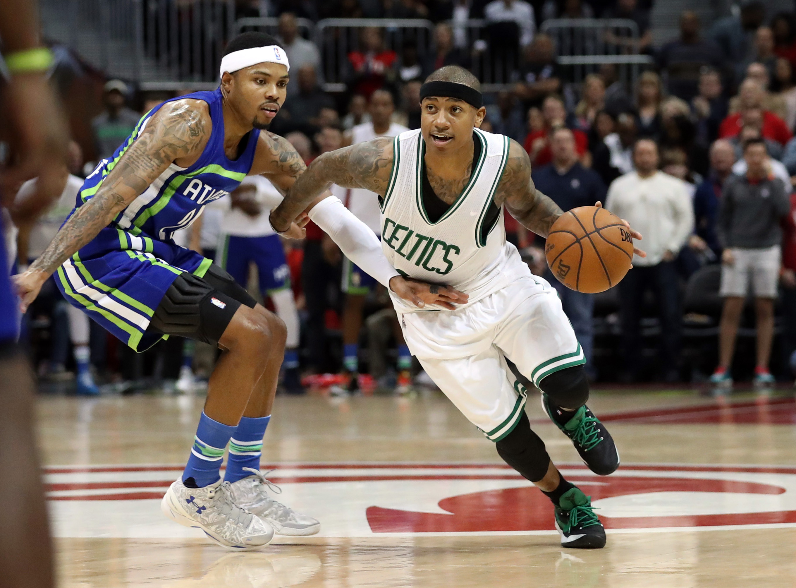 Jan 13, 2017; Atlanta, GA, USA; Boston Celtics guard Isaiah Thomas (4) drives against Atlanta Hawks forward Kent Bazemore (24) in the fourth quarter of their game at Philips Arena. The Celtics won 103-101. Mandatory Credit: Jason Getz-USA TODAY Sports