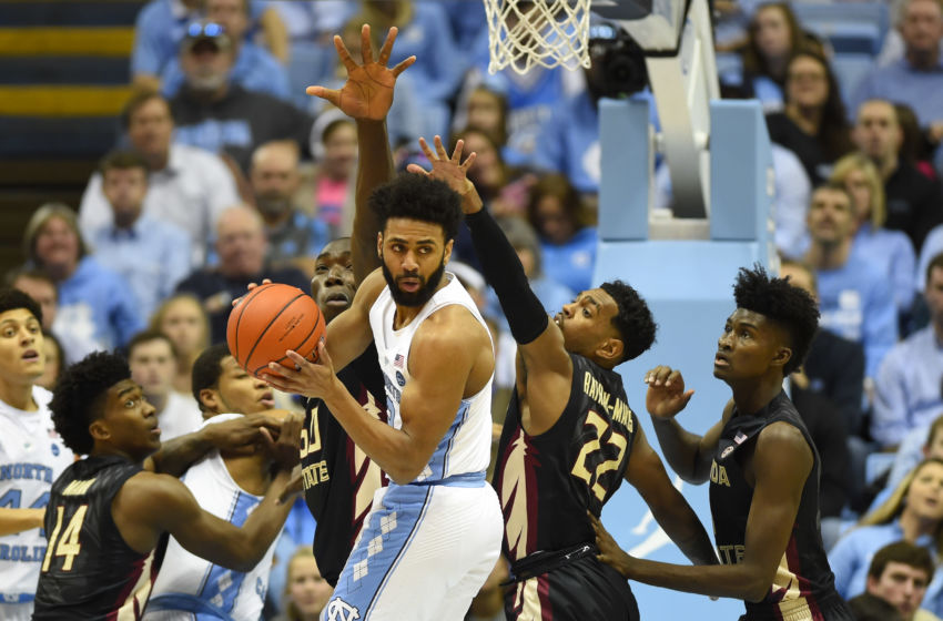 Jan 14, 2017; Chapel Hill, NC, USA; North Carolina Tar Heels guard Joel Berry II (2) passes the ball as Florida State Seminoles guard Terance Mann (14) and Florida State Seminoles center Michael Ojo (50) and guard Xavier Rathan-Mayes (22) and forward Jonathan Isaac (1) defend in the first half at Dean E. Smith Center. Mandatory Credit: Bob Donnan-USA TODAY Sports