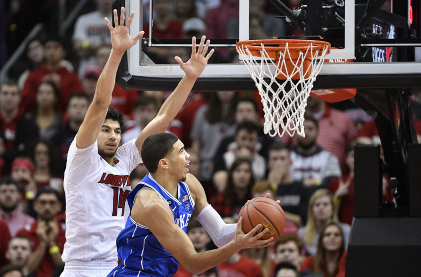 Jan 14, 2017; Louisville, KY, USA; Duke Blue Devils forward Jayson Tatum (0) shoots against Louisville Cardinals forward Anas Mahmoud (14) during the second half at KFC Yum! Center. Louisville defeated Duke 78-69. Mandatory Credit: Jamie Rhodes-USA TODAY Sports