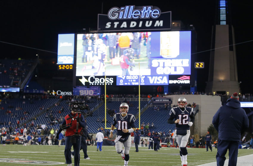 Jan 14, 2017; Foxborough, MA, USA; New England Patriots quarterbacks Jimmy Garoppolo (10) and Tom Brady (12) take the field before the AFC Divisional playoff game against the Houston Texans at Gillette Stadium. Mandatory Credit: David Butler III-USA TODAY Sports