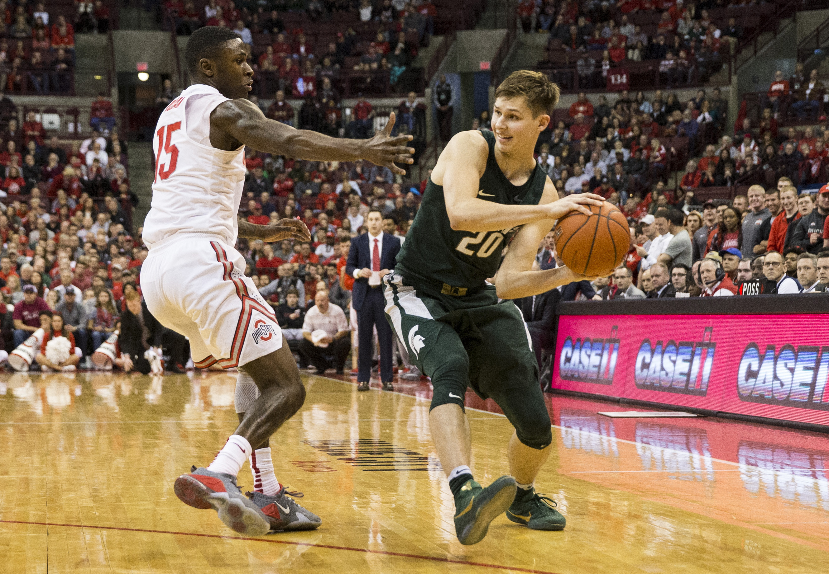 Jan 15, 2017; Columbus, OH, USA; Michigan State Spartans guard Matt McQuaid (20) looks to pass around Ohio State Buckeyes guard Kam Williams (15) at Value City Arena. Ohio State won the game 72-67. Mandatory Credit: Greg Bartram-USA TODAY Sports