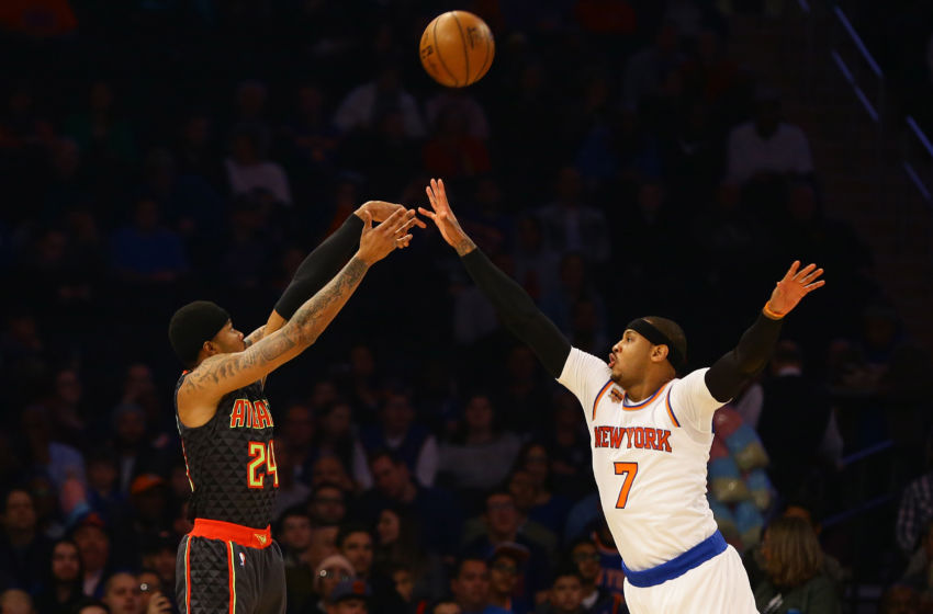 Jan 16, 2017; New York, NY, USA; New York Knicks forward Carmelo Anthony (7) attempts to block a shot by Atlanta Hawks guard Kent Bazemore (24) during the first half at Madison Square Garden. Mandatory Credit: Andy Marlin-USA TODAY Sports