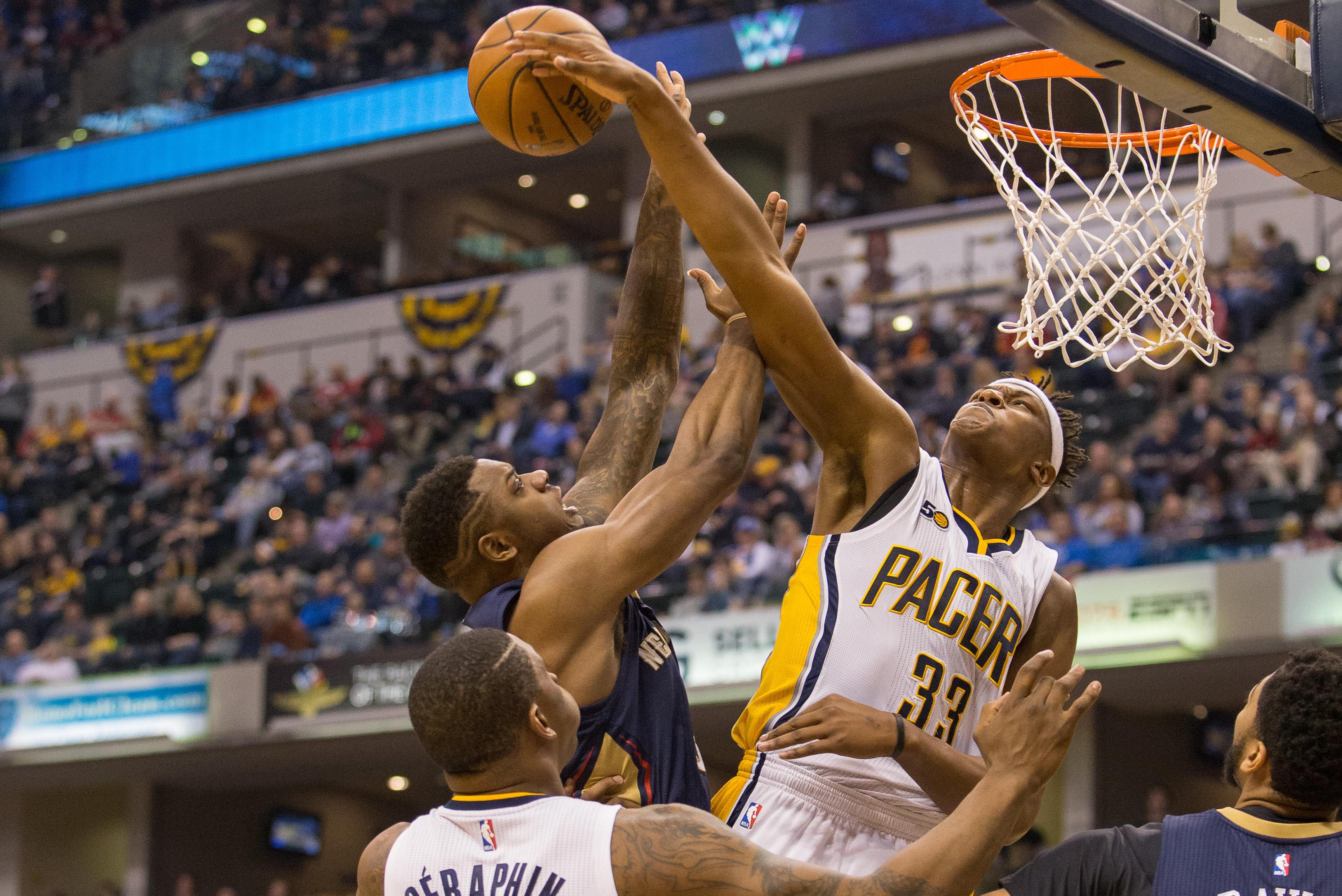 Jan 16, 2017; Indianapolis, IN, USA; Indiana Pacers center Myles Turner (33) blocks the shot of New Orleans Pelicans forward Terrence Jones (9) in the first half of the game at Bankers Life Fieldhouse. Mandatory Credit: Trevor Ruszkowski-USA TODAY Sports