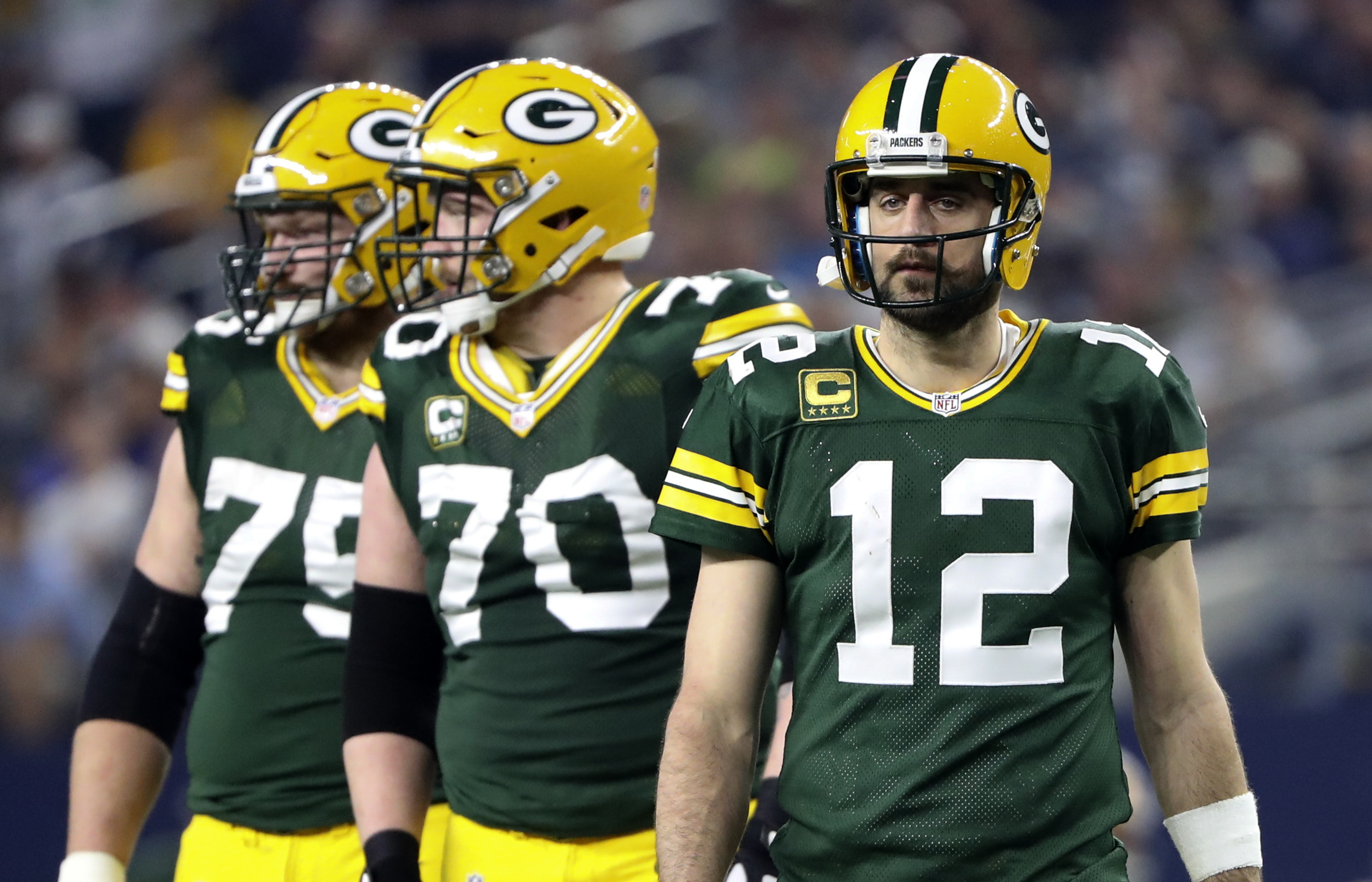 Jan 15, 2017; Arlington, TX, USA; Green Bay Packers quarterback Aaron Rodgers (12) and guard T.J. Lang (70) in action during the game against the Dallas Cowboys in the NFC Divisional playoff game at AT&T Stadium. Mandatory Credit: Kevin Jairaj-USA TODAY Sports