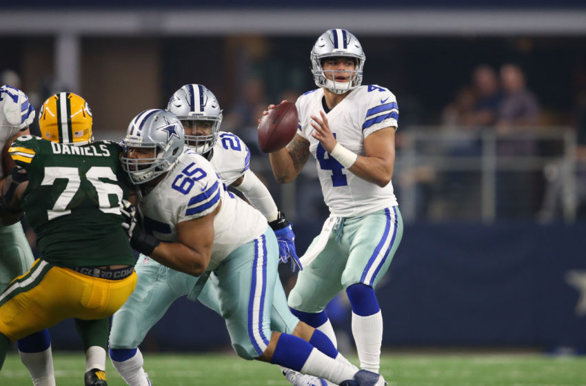 Jan 15, 2017; Arlington, TX, USA; Dallas Cowboys quarterback Dak Prescott (4) throws in the pocket against the Green Bay Packers in the NFC Divisional playoff game at AT&T Stadium. Mandatory Credit: Matthew Emmons-USA TODAY Sports
