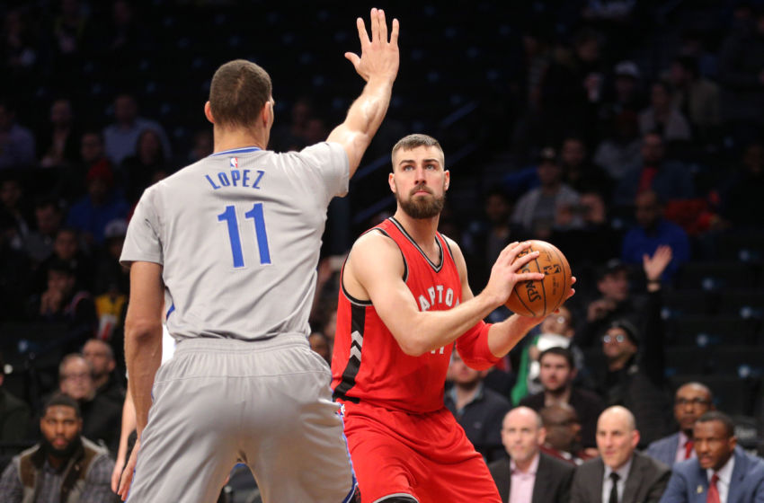 Jan 17, 2017; Brooklyn, NY, USA; Toronto Raptors center Jonas Valanciunas (17) controls the ball against Brooklyn Nets center Brook Lopez (11) during the first quarter at Barclays Center. Mandatory Credit: Brad Penner-USA TODAY Sports