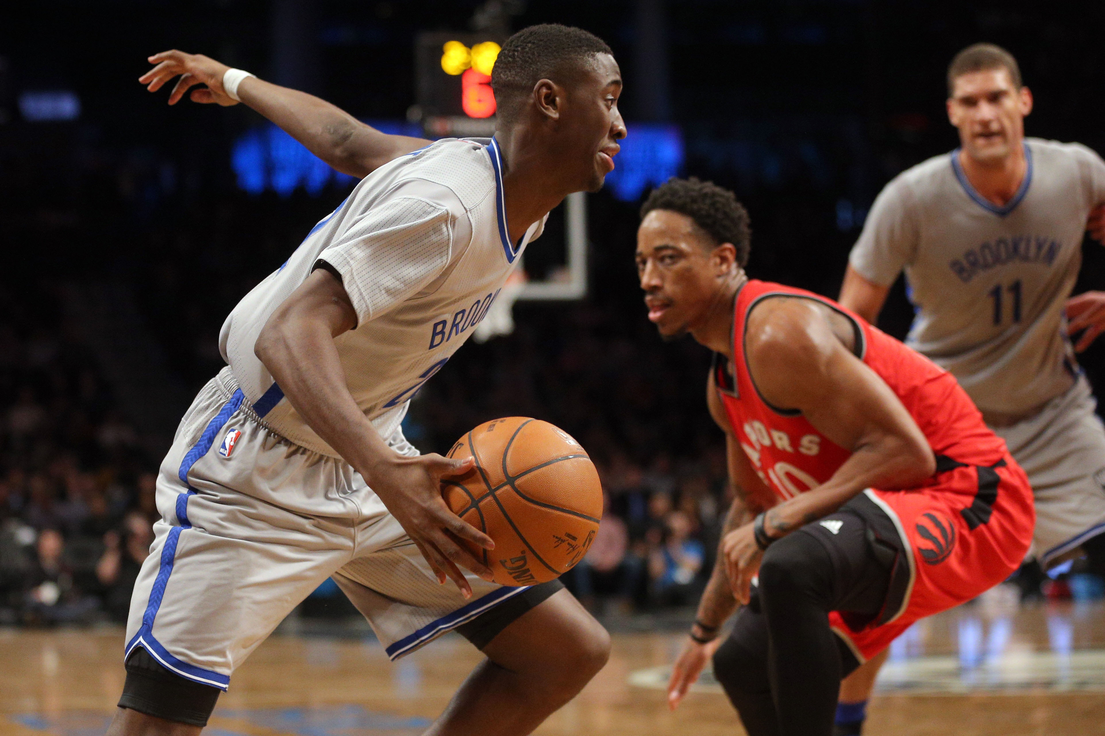 Jan 17, 2017; Brooklyn, NY, USA; Brooklyn Nets shooting guard Caris LeVert (22) drives past Toronto Raptors shooting guard DeMar DeRozan (10) during the third quarter at Barclays Center. Mandatory Credit: Brad Penner-USA TODAY Sports