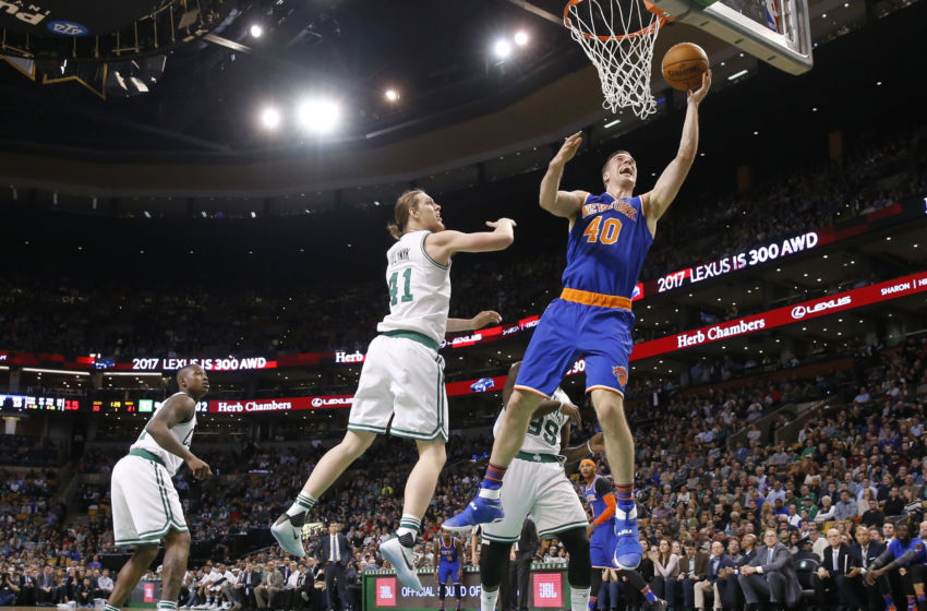 Jan 18, 2017; Boston, MA, USA; New York Knicks center Marshall Plumlee (40) shoots against Boston Celtics center Kelly Olynyk (41) in the first quarter at TD Garden. Mandatory Credit: David Butler II-USA TODAY Sports