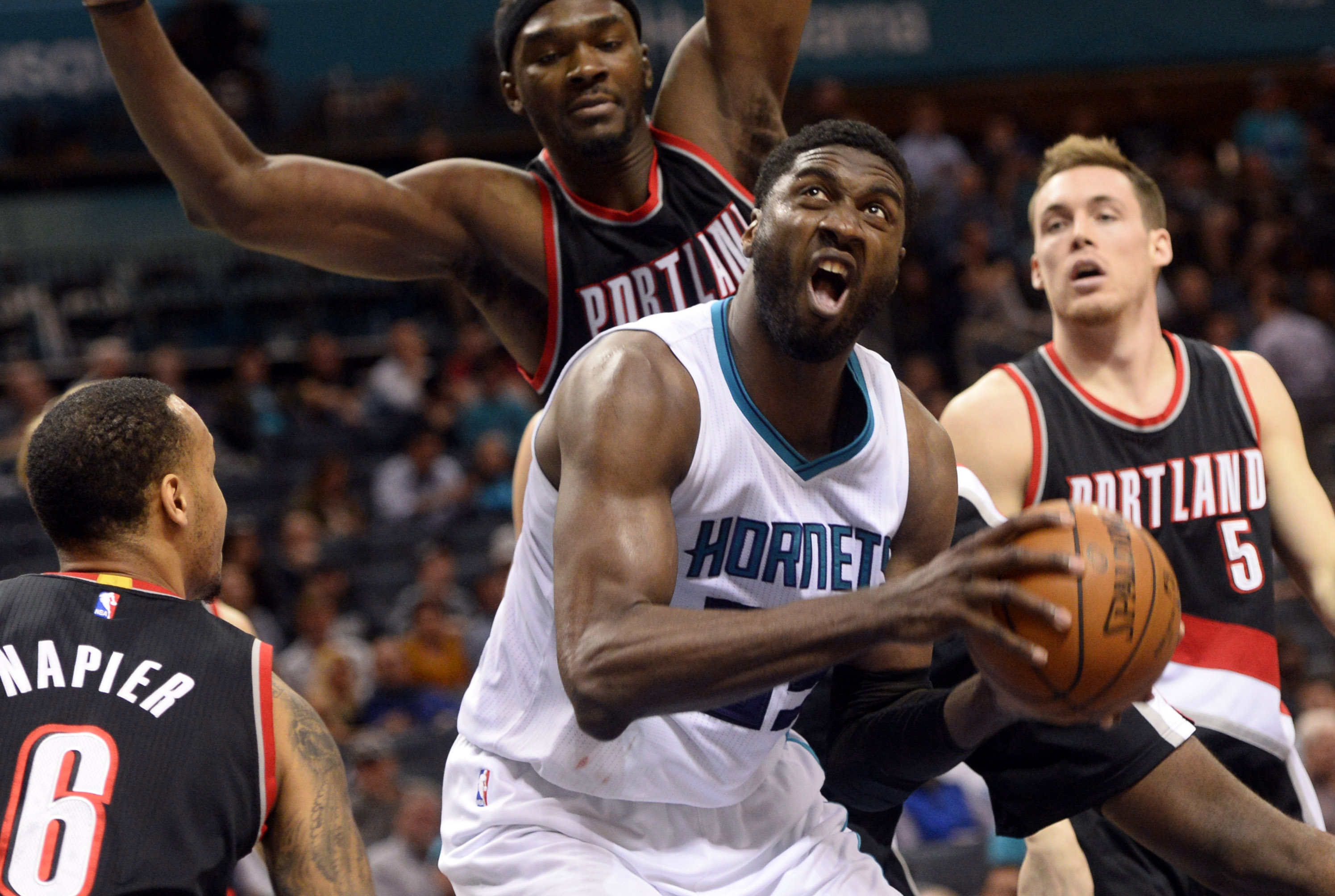 Jan 18, 2017; Charlotte, NC, USA; Charlotte Hornets center Roy Hibbert (55) looks to dunk he ball through the Portland Trail Blazers guard Shabazz Napier (6), forward Noah Vonleh (21) and guard forward Pat Connaughton (5) during the second half of the game at the Spectrum Center. Hornets win 107-85. Mandatory Credit: Sam Sharpe-USA TODAY Sports