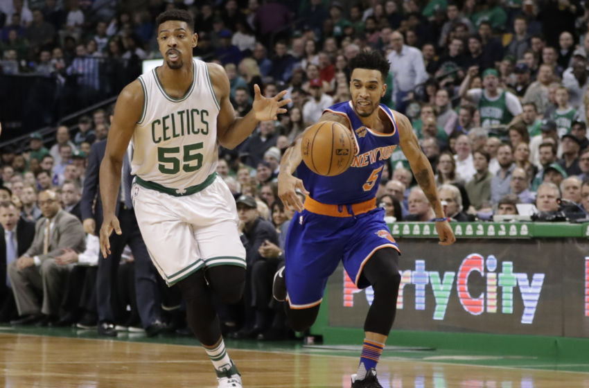 Jan 18, 2017; Boston, MA, USA; New York Knicks guard Courtney Lee (5) steals the ball from Boston Celtics forward Jordan Mickey (55) in the second half at TD Garden. The Knicks defeated the Celtics 117-106. Mandatory Credit: David Butler II-USA TODAY Sports