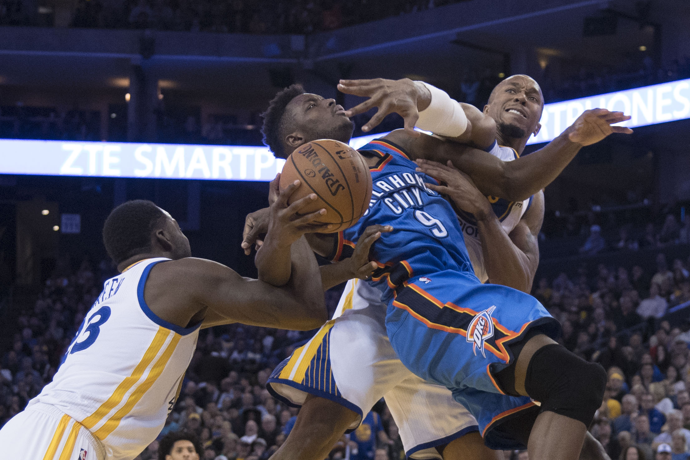 January 18, 2017; Oakland, CA, USA; Oklahoma City Thunder forward Jerami Grant (9) is fouled by Golden State Warriors forward Draymond Green (23) during the fourth quarter at Oracle Arena. The Warriors defeated the Thunder 121-100. Mandatory Credit: Kyle Terada-USA TODAY Sports
