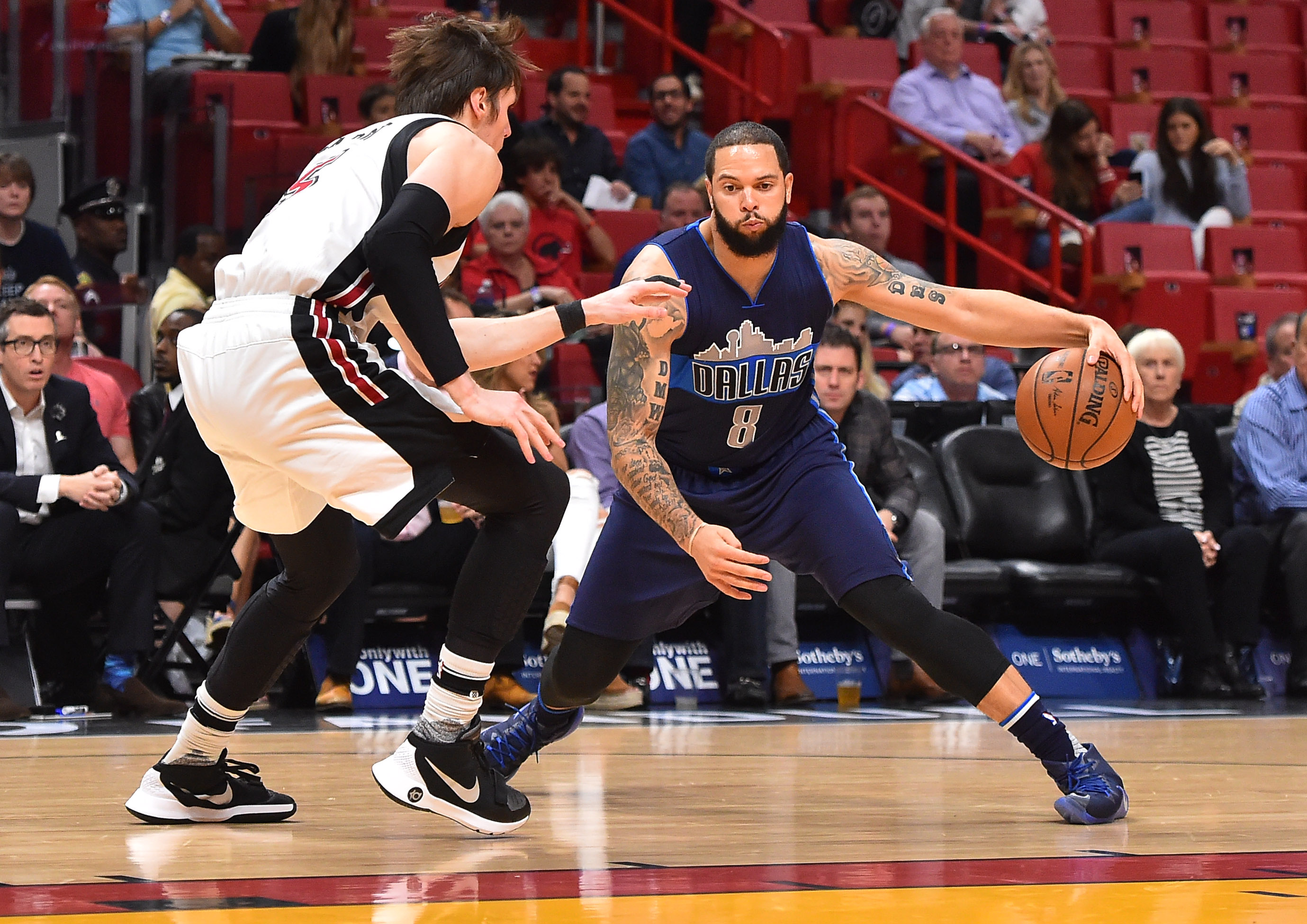 Jan 19, 2017; Miami, FL, USA; Dallas Mavericks guard Deron Williams (8) drives the ball around Miami Heat forward Luke Babbitt (5) during the first half at American Airlines Arena. Mandatory Credit: Jasen Vinlove-USA TODAY Sports