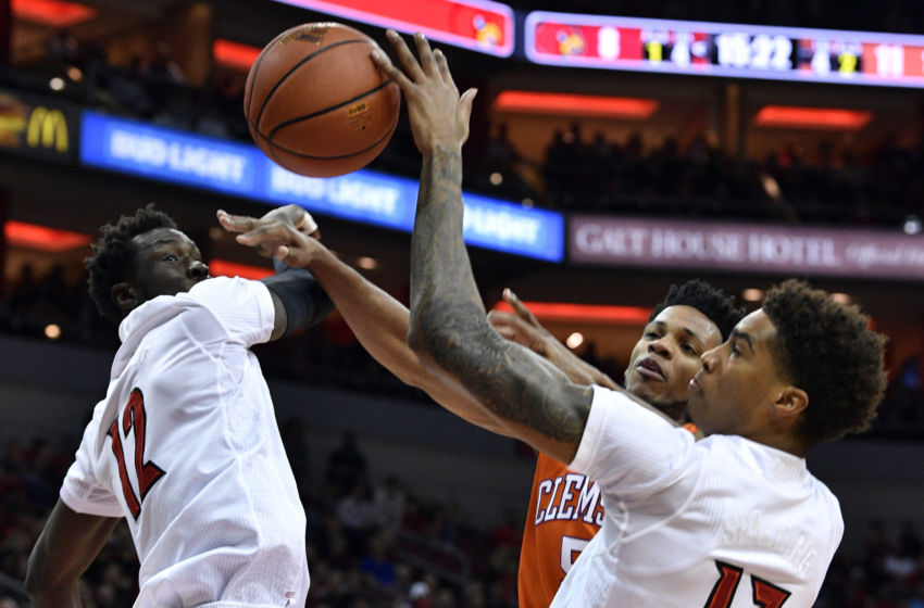 Jan 19, 2017; Louisville, KY, USA; Louisville Cardinals forward Ray Spalding (13) blocks the shot of Clemson Tigers forward Jaron Blossomgame (5) during the first half at KFC Yum! Center. Mandatory Credit: Jamie Rhodes-USA TODAY Sports