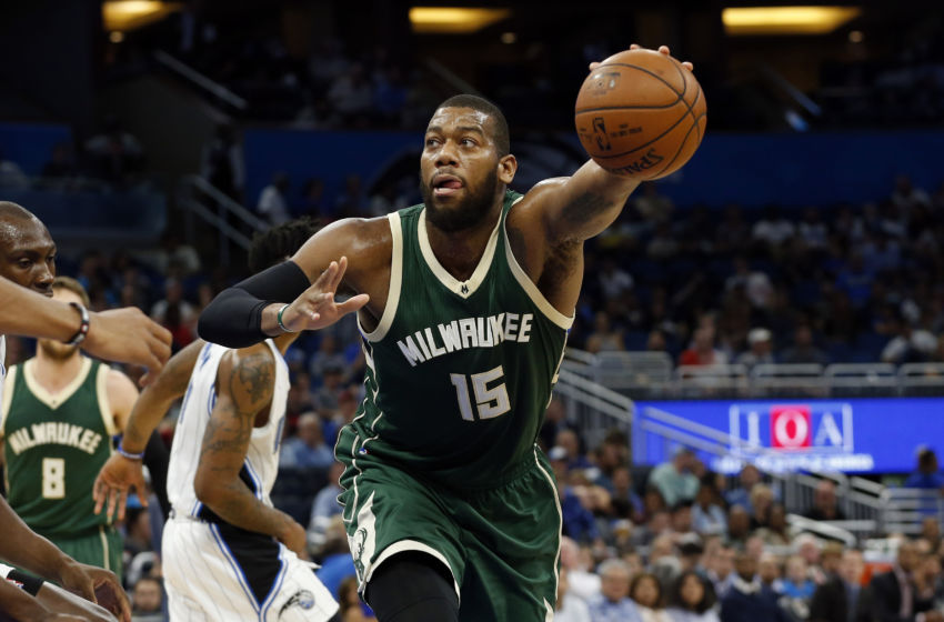 Jan 20, 2017; Orlando, FL, USA; Milwaukee Bucks center Greg Monroe (15) grabs the ball against the Orlando Magic during the first half at Amway Center. Mandatory Credit: Kim Klement-USA TODAY Sports