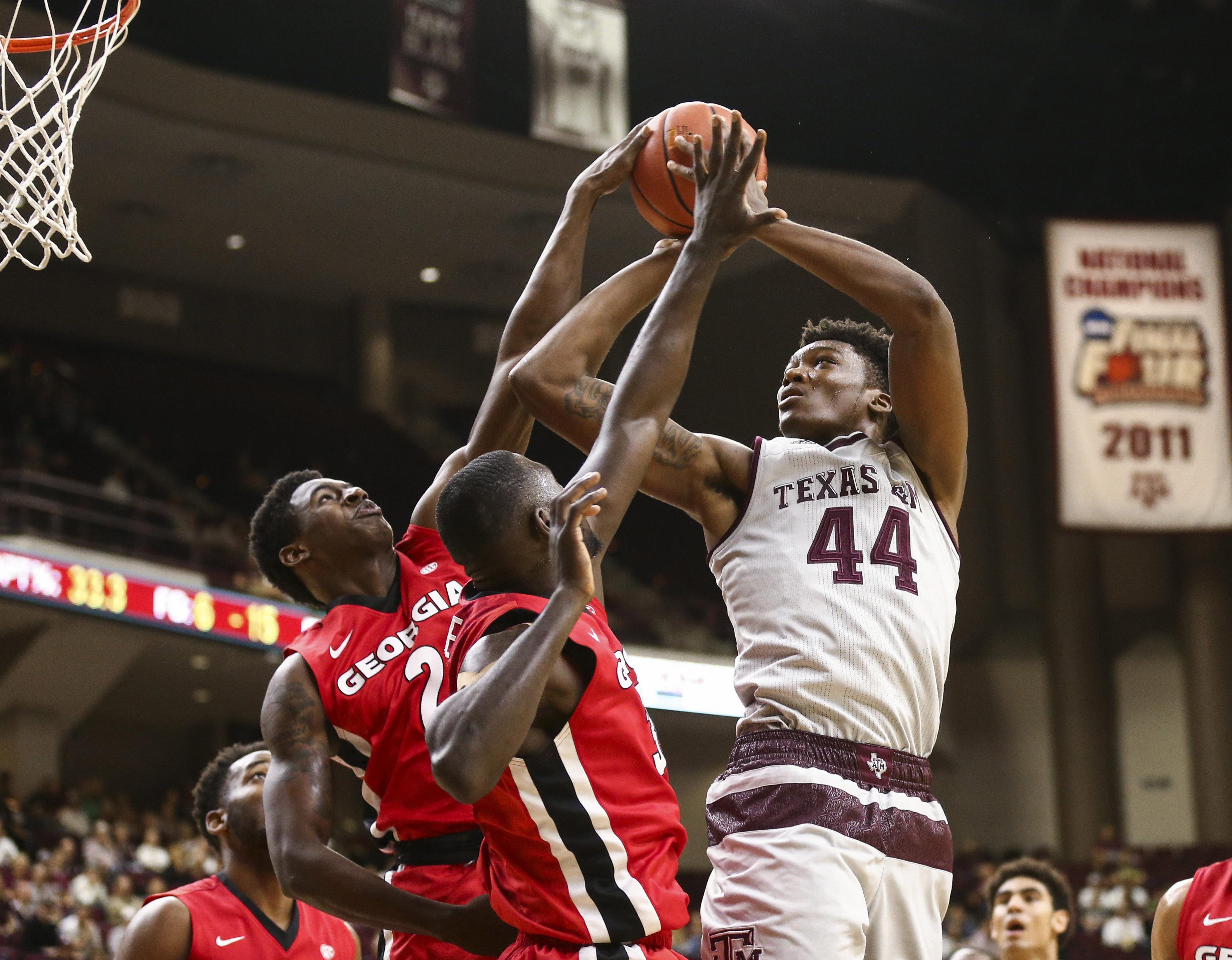 9826999-ncaa-basketball-georgia-at-texas-aampampm