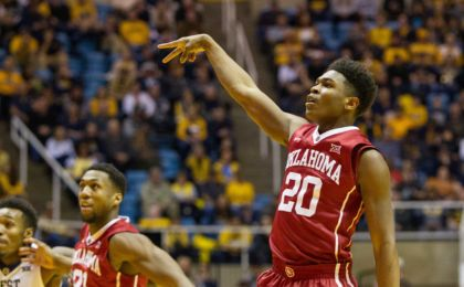Jan 18, 2017; Morgantown, WV, USA; Oklahoma Sooners guard Kameron McGusty (20) shoots a three pointer during the first half against the West Virginia Mountaineers at WVU Coliseum. Mandatory Credit: Ben Queen-USA TODAY Sports