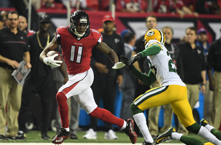 Jan 22, 2017; Atlanta, GA, USA; Atlanta Falcons wide receiver Julio Jones (11) runs for a touchdown against Green Bay Packers cornerback Damarious Randall (23) during the third quarter in the 2017 NFC Championship Game at the Georgia Dome. Mandatory Credit: John David Mercer-USA TODAY Sports