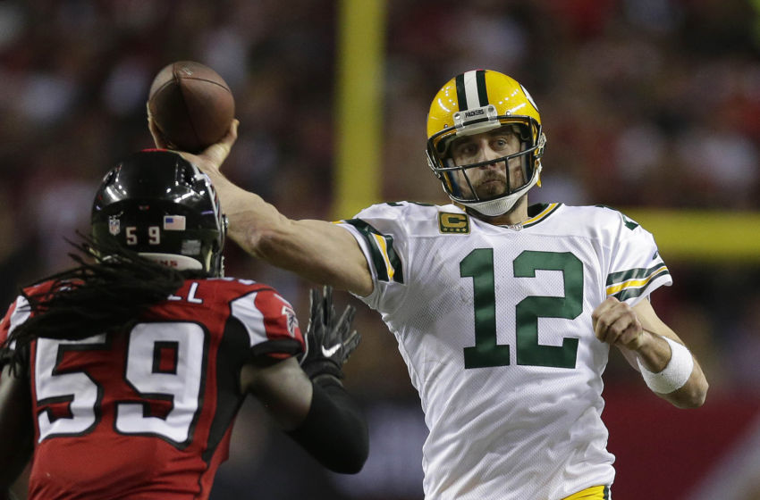 Jan 22, 2017; Atlanta, GA, USA; Green Bay Packers quarterback Aaron Rodgers (12) throws against Atlanta Falcons outside linebacker De'Vondre Campbell (59) during the fourth quarter in the 2017 NFC Championship Game at the Georgia Dome. Mandatory Credit: Rick Wood/Milwaukee Journal Sentinel via USA TODAY NETWORK