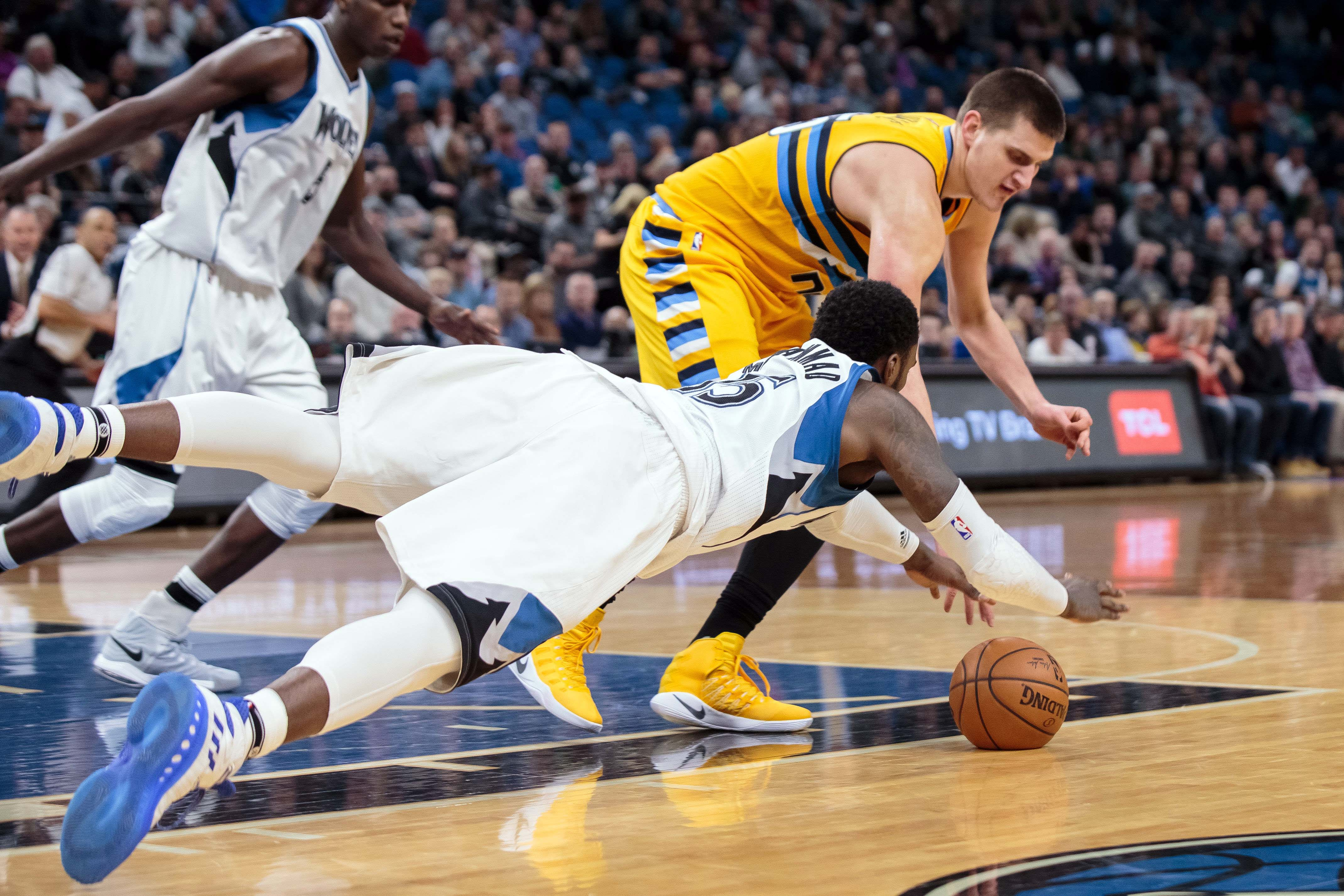 Jan 22, 2017; Minneapolis, MN, USA; Minnesota Timberwolves forward Shabazz Muhammad (15) dives for a loose ball in the third quarter against the Denver Nuggets forward Nikola Jokic (15) at Target Center. The Minnesota Timberwolves beat the Denver Nuggets 111-108. Mandatory Credit: Brad Rempel-USA TODAY Sports