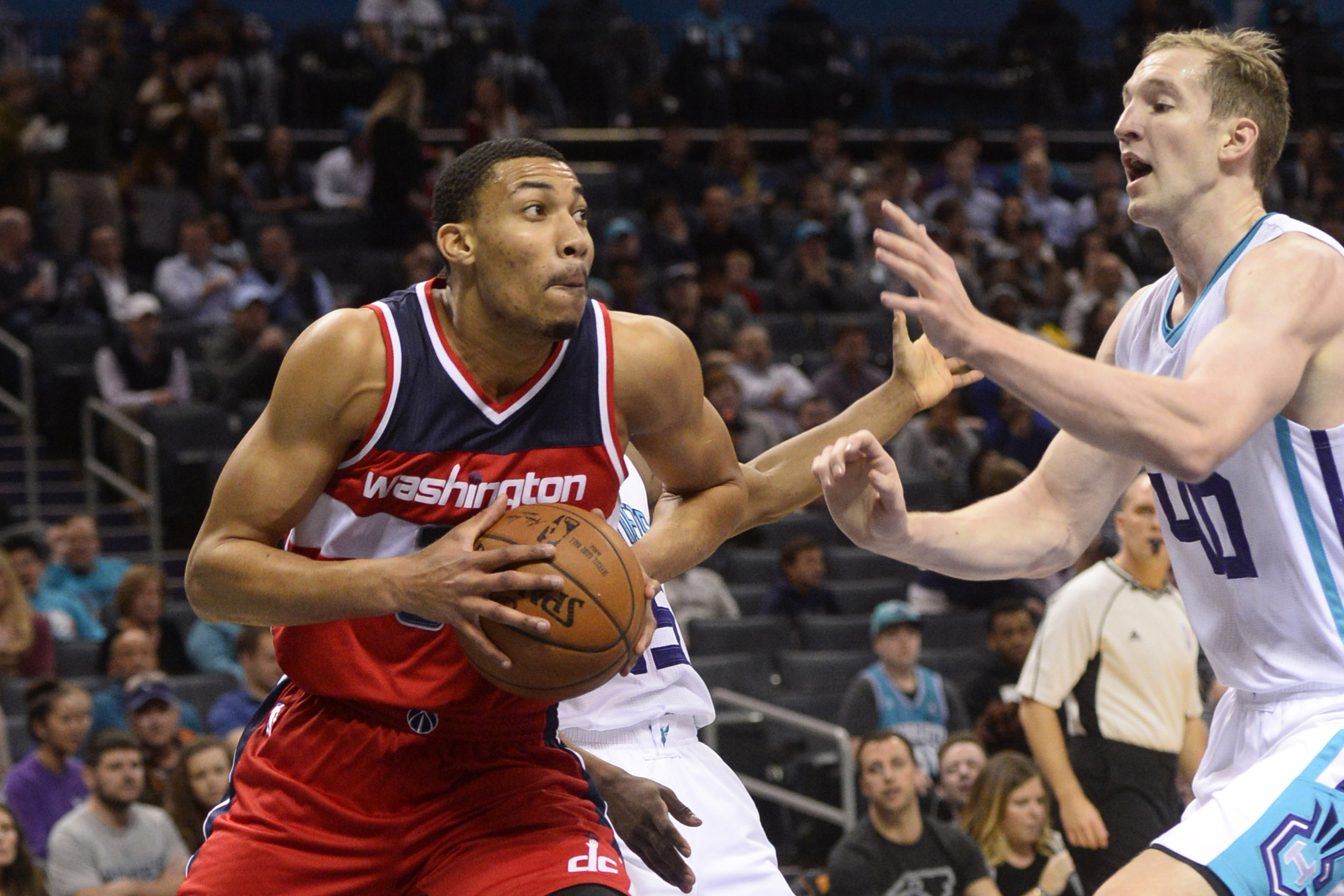 Jan 23, 2017; Charlotte, NC, USA; Washington Wizards forward Otto Porter (22) looks to shoot as he is defended by Charlotte Hornets forward center Cody Zeller (40) during the first half of the game at the Spectrum Center. Mandatory Credit: Sam Sharpe-USA TODAY Sports